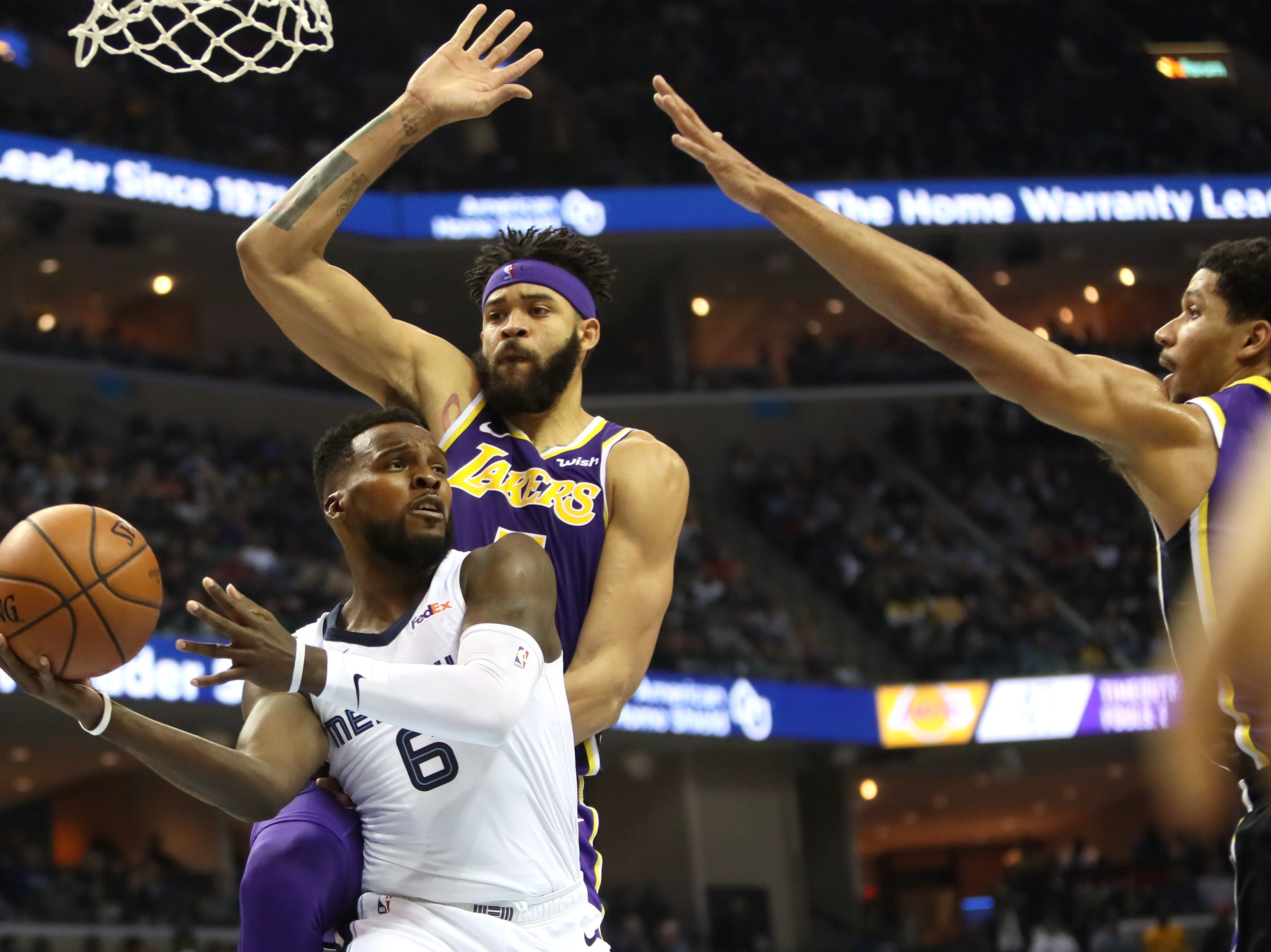 Memphis Grizzlies guard Shelvin Mack looks to pass the ball as Los Angeles Lakers center JaVale McGee defends at the FedExForum on Saturday, Dec. 6, 2018.