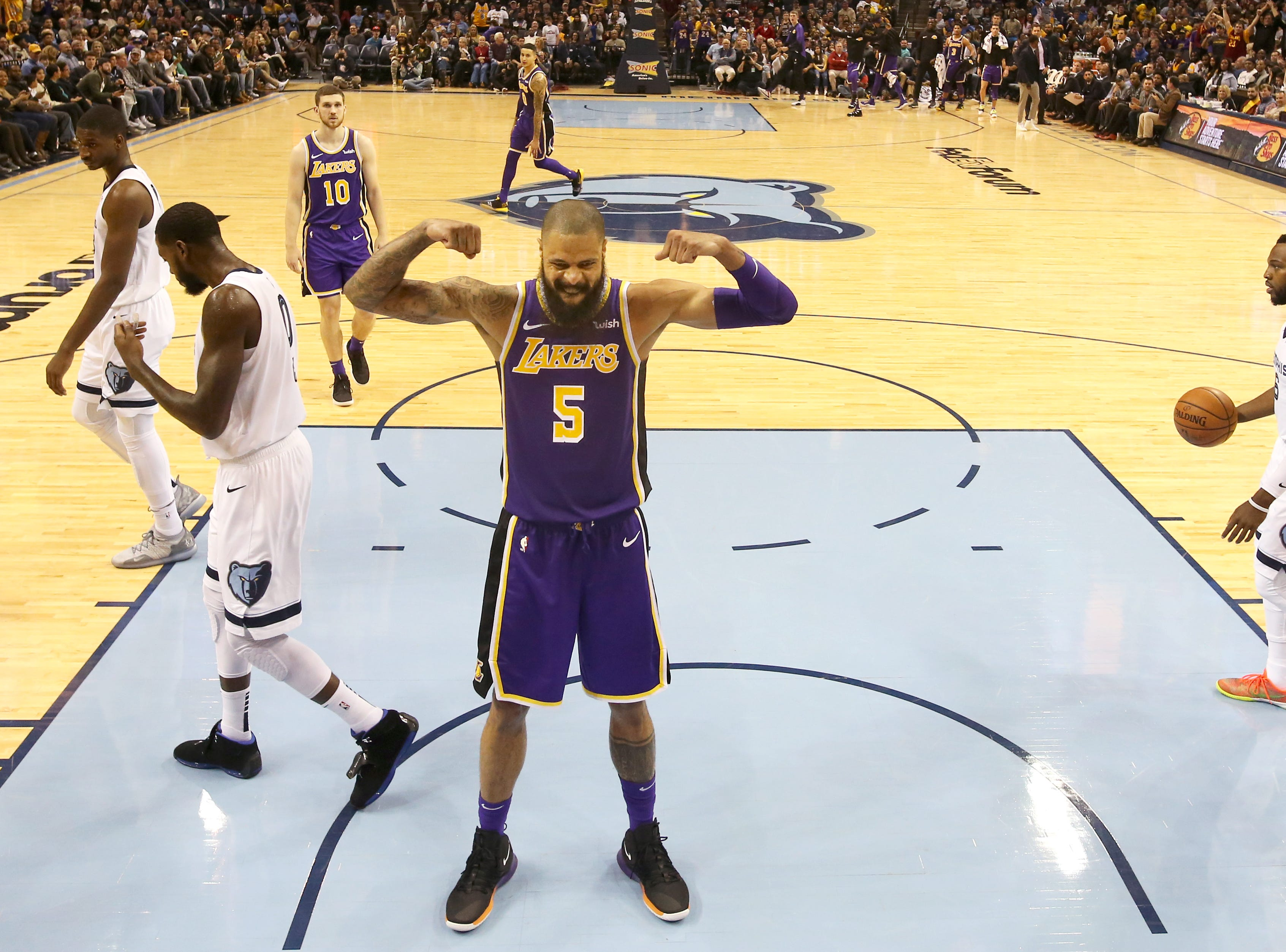 Los Angeles Lakers center Tyson Chandler flexes after a dunk by LeBron James during their game against the Memphis Grizzlies at the FedExForum on Saturday, Dec. 8, 2018.