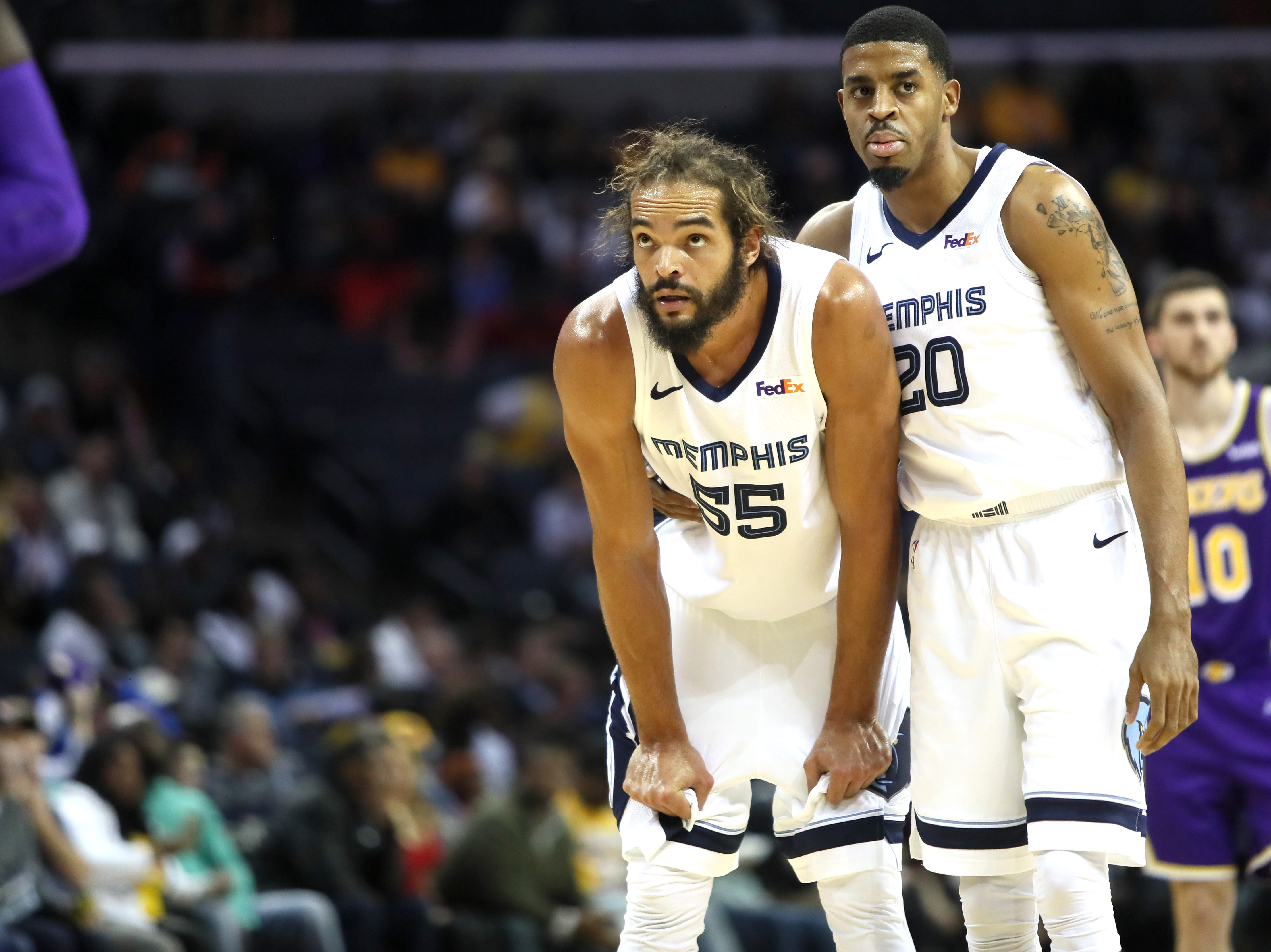Memphis Grizzlies forward Joakim Noah is held by  his teammate DJ Stephens after committing a foul against the Los Angeles Lakers during their game at the FedExForum on Saturday, Dec. 8, 2018.