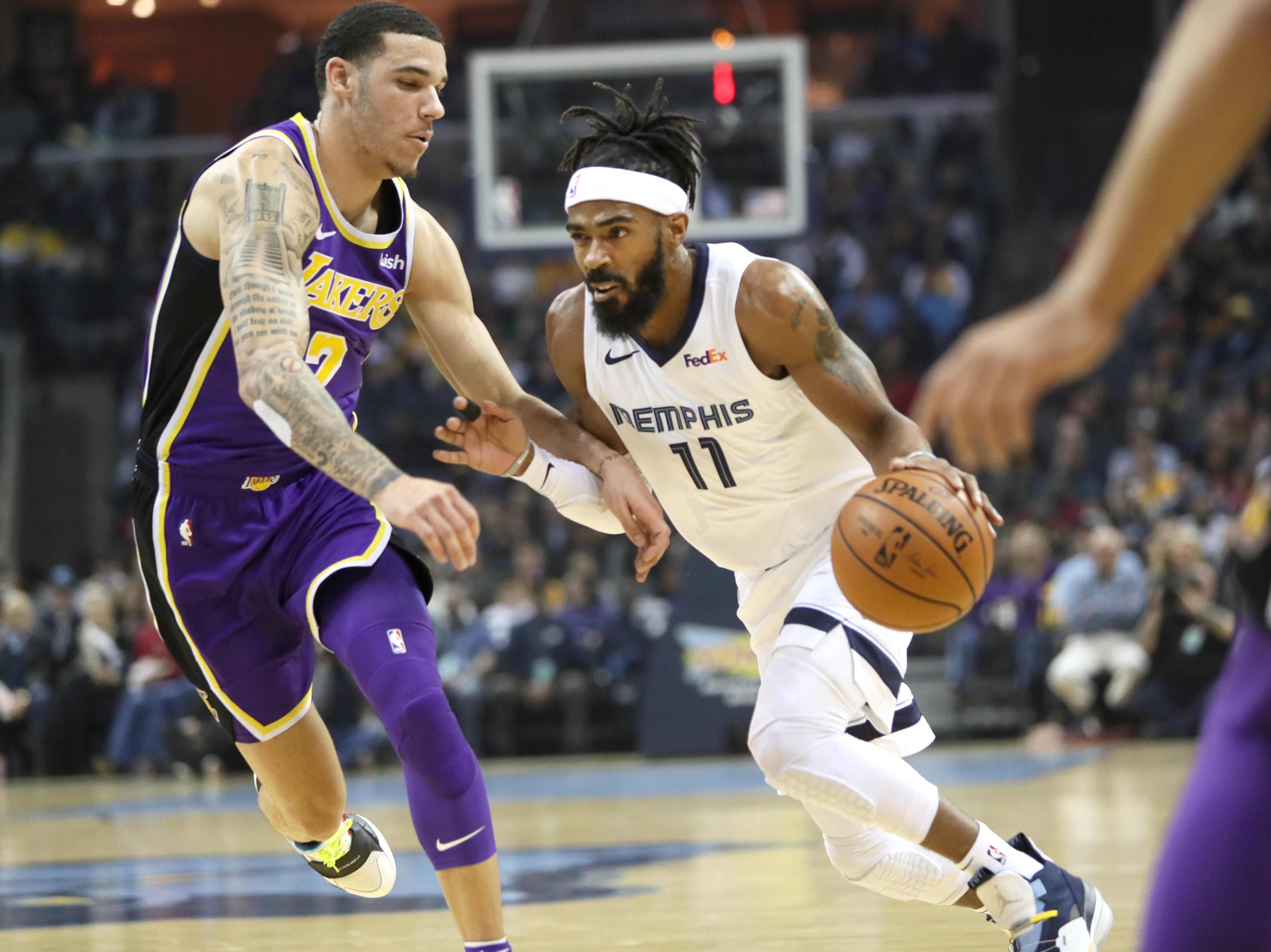 Memphis Grizzlies guard Mike Conley drives past Los Angeles Lakers defender Lonzo Ball at the FedExForum on Saturday, Dec. 6, 2018.