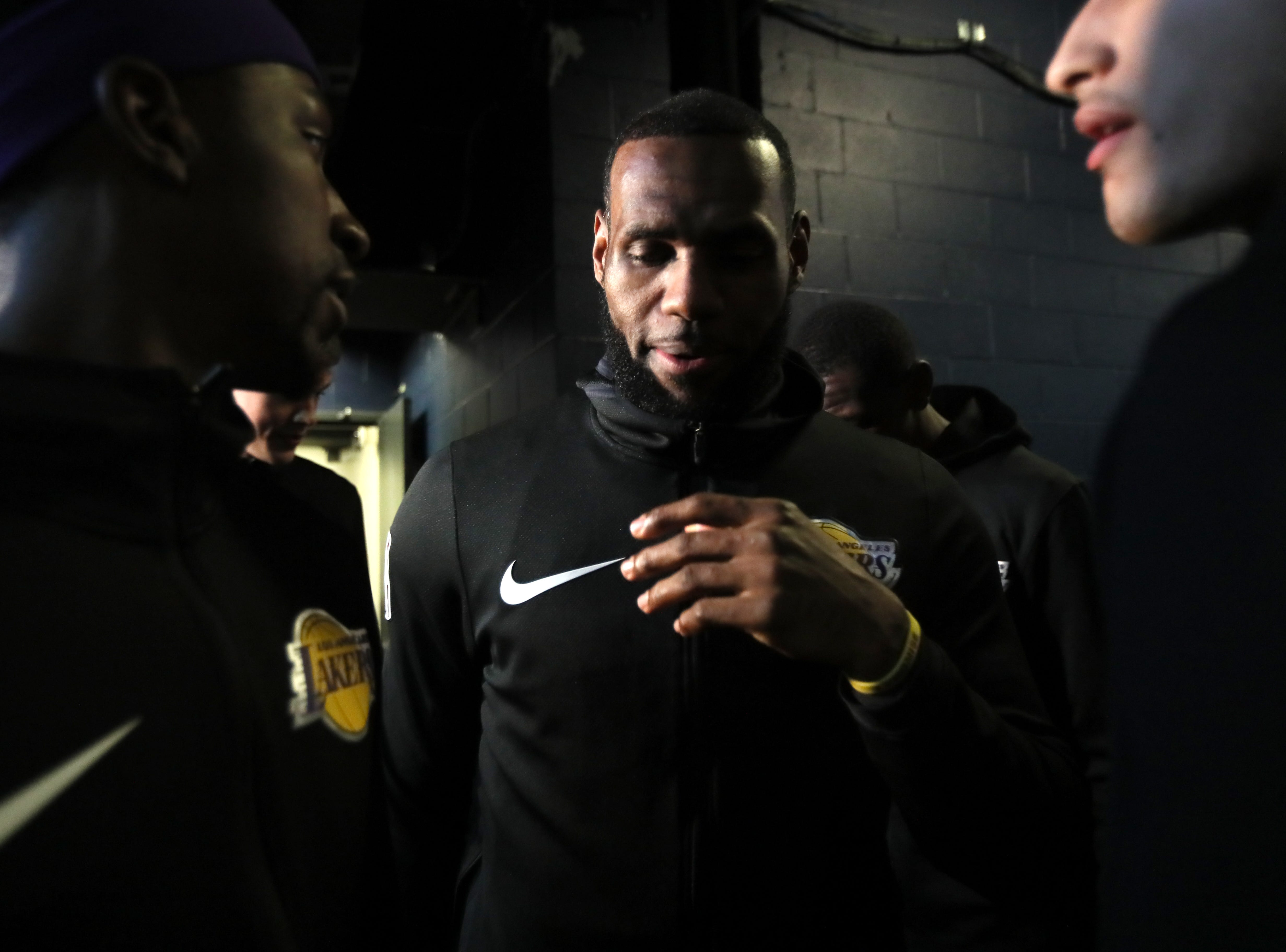 Los Angeles Lakers forward LeBrron James huddles up with his teammates before their game against the Memphis Grizzlies at the FedExForum on Saturday, Dec. 6, 2018.