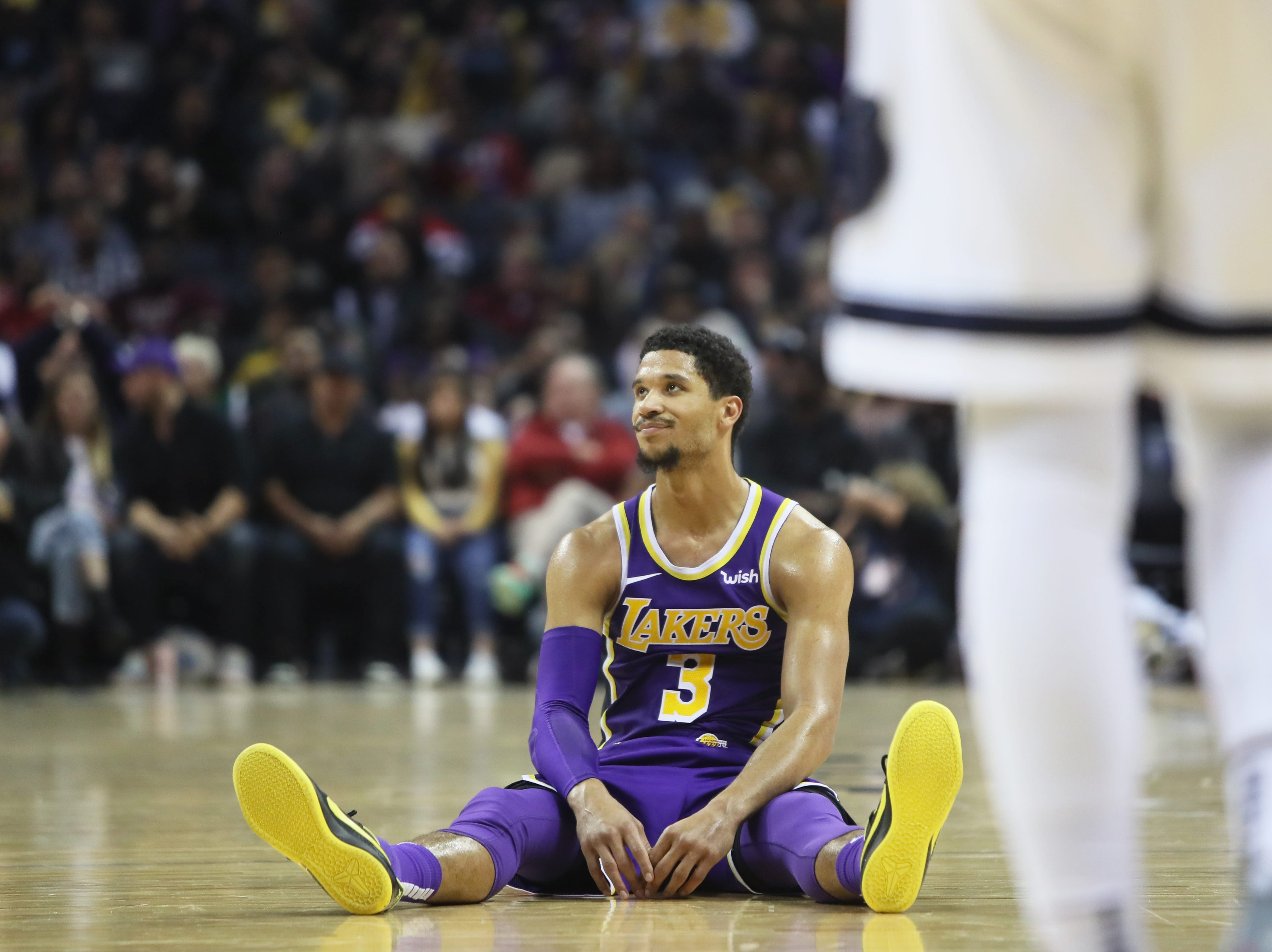 Los Angeles Lakers fguard Josh Hart sits on the floor after causing a foul during against the Memphis Grizzlies during their game at the FedExForum on Saturday, Dec. 8, 2018.