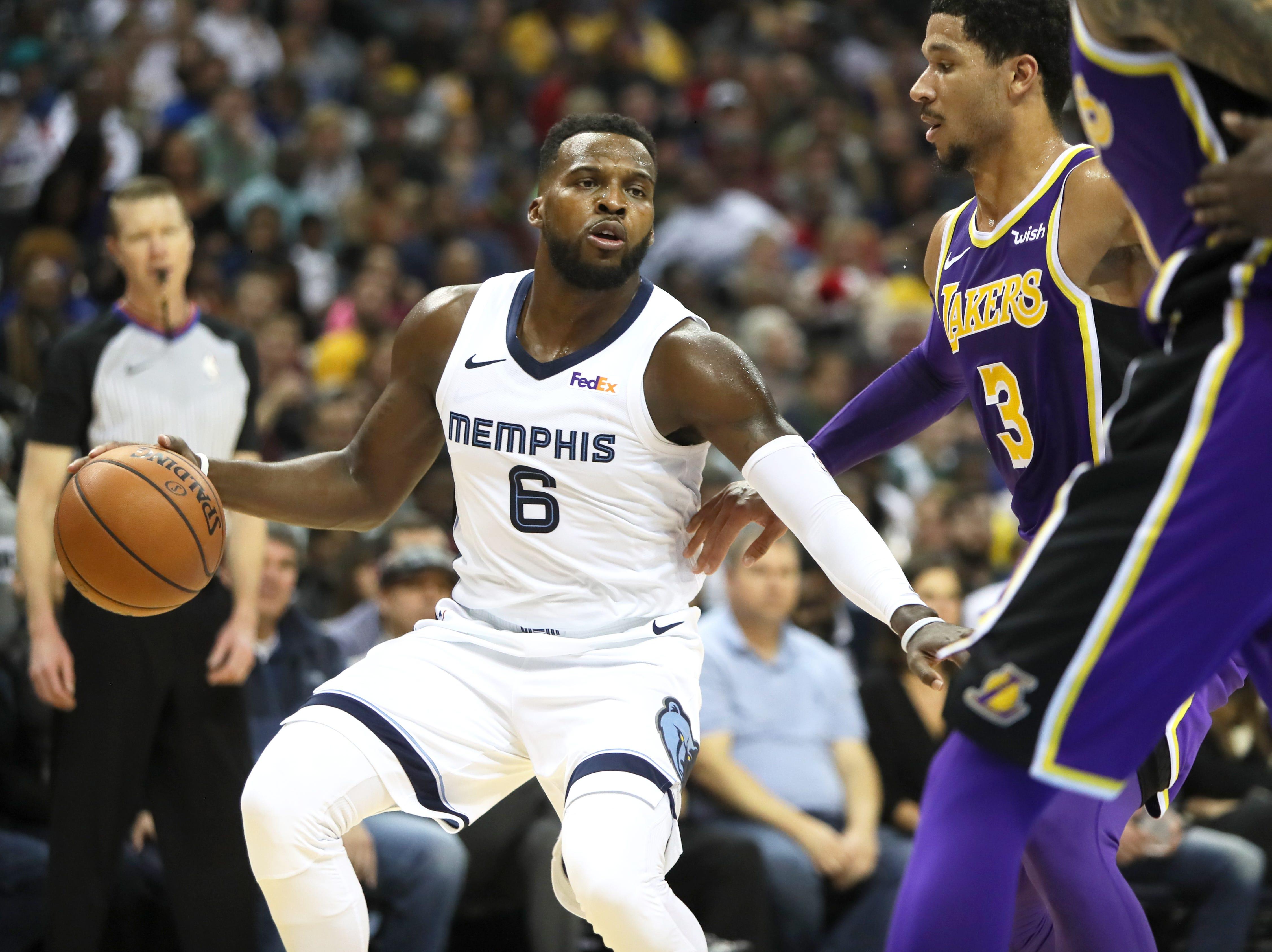 Memphis Grizzlies guard Shelvin Mack tries to get past  Los Angeles Lakers defender Josh Hart at the FedExForum on Saturday, Dec. 6, 2018.