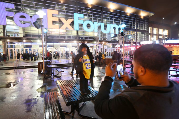 Wardell Brooks takes a photo of his son Xavier, 4, in a Lebron James jersey outside the FedExForum as the Memphis Grizzlies take on the Los Angeles Lakers on Saturday, Dec. 6, 2018.