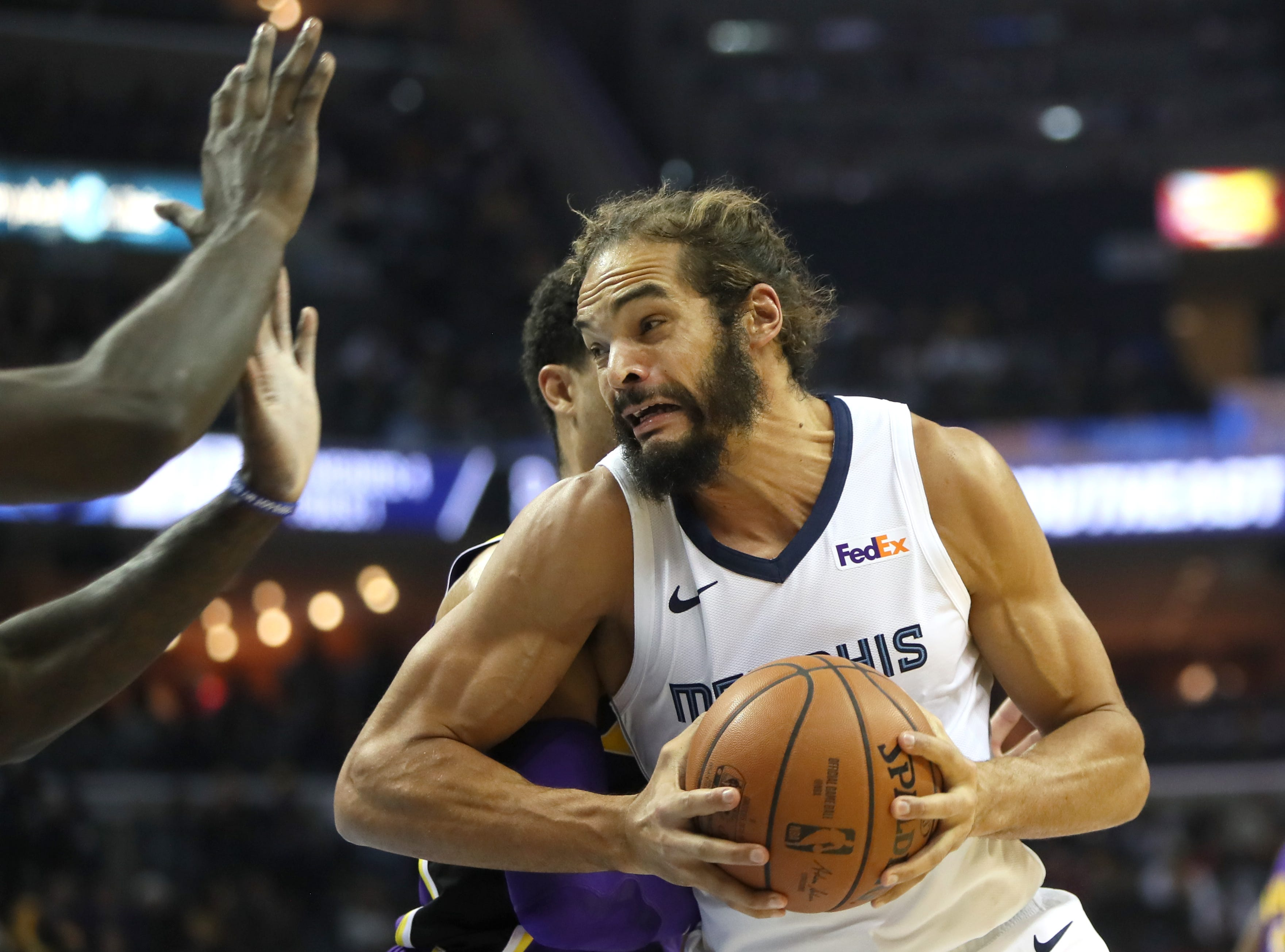 Memphis Grizzlies forward Joakim Noah tries to spin past Los Angeles Lakers defenders at the FedExForum on Saturday, Dec. 6, 2018.