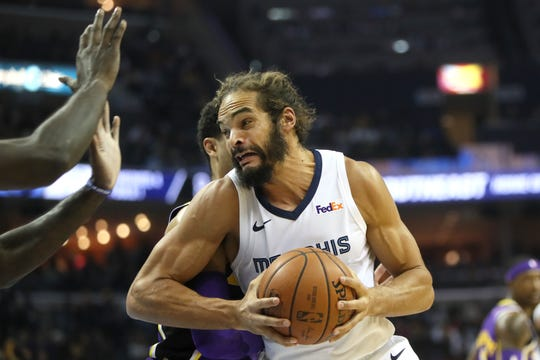 Grizzlies forward Joakim Noah tries to spin past Lakers defenders at FedExForum on Dec. 6.