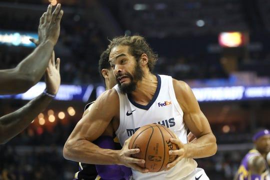 Grizzlies forward Joakim Noah tries to spin past Lakers defenders at FedExForum on Dec. 6.