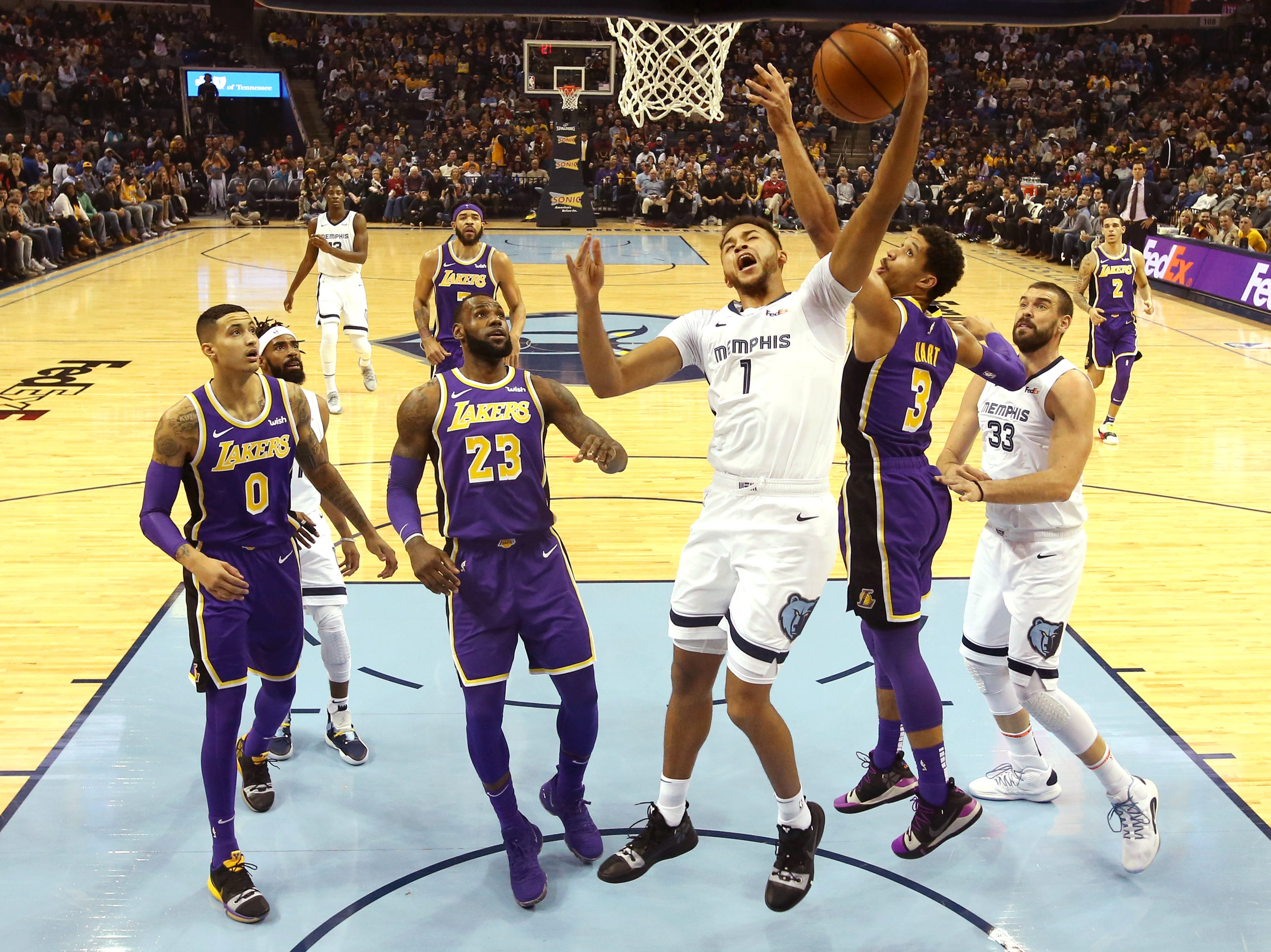 Memphis Grizzlies Kyle Anderson tries to lay the ball up past Los Angeles Lakers guard Josh Hart during their game at the FedExForum on Saturday, Dec. 8, 2018.