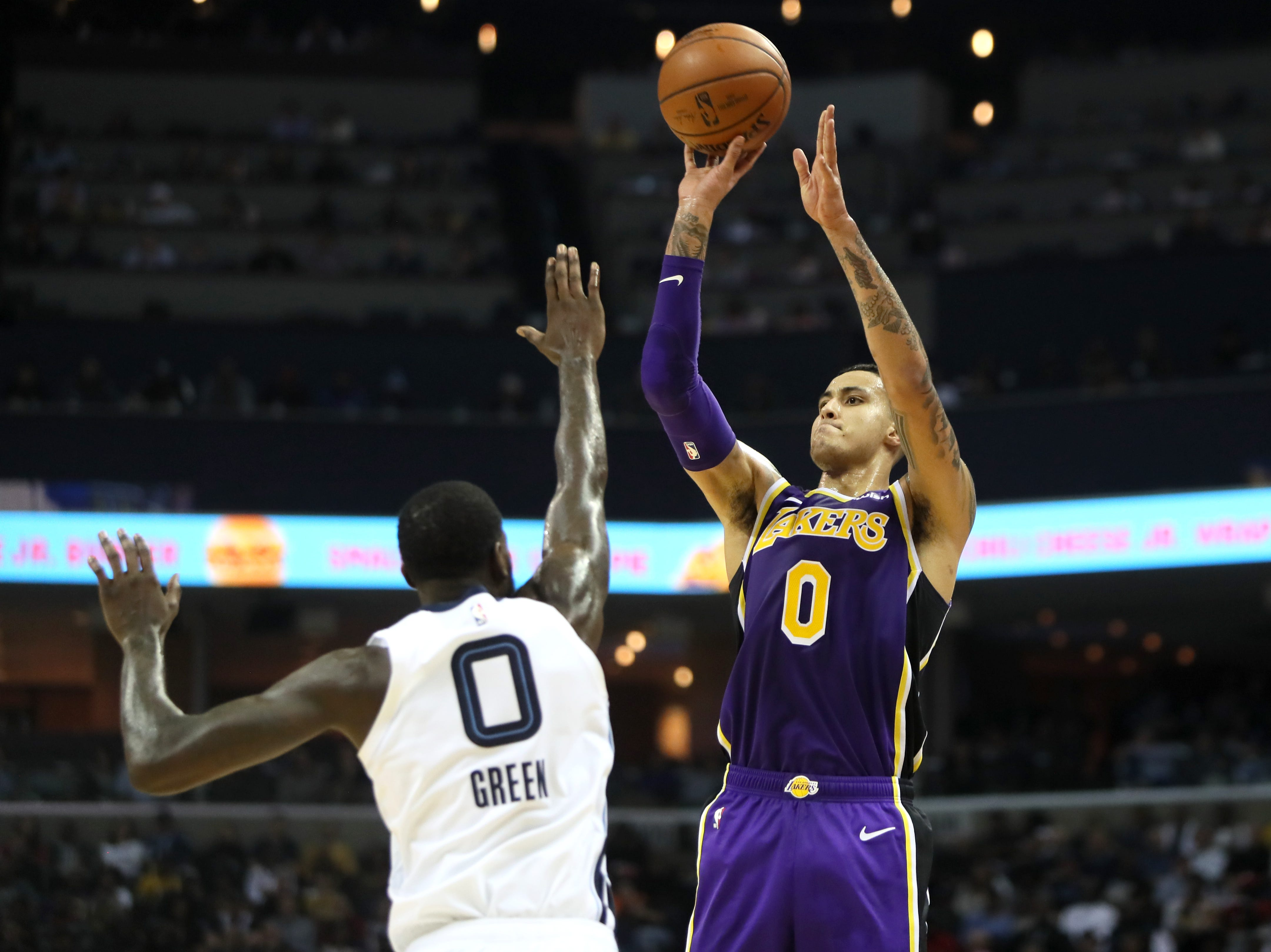 Los Angeles Lakers forward Kyle Kuzma shoots a 3-pointer over Memphis Grizzlies forward JaMychal Green during their game at the FedExForum on Saturday, Dec. 8, 2018.