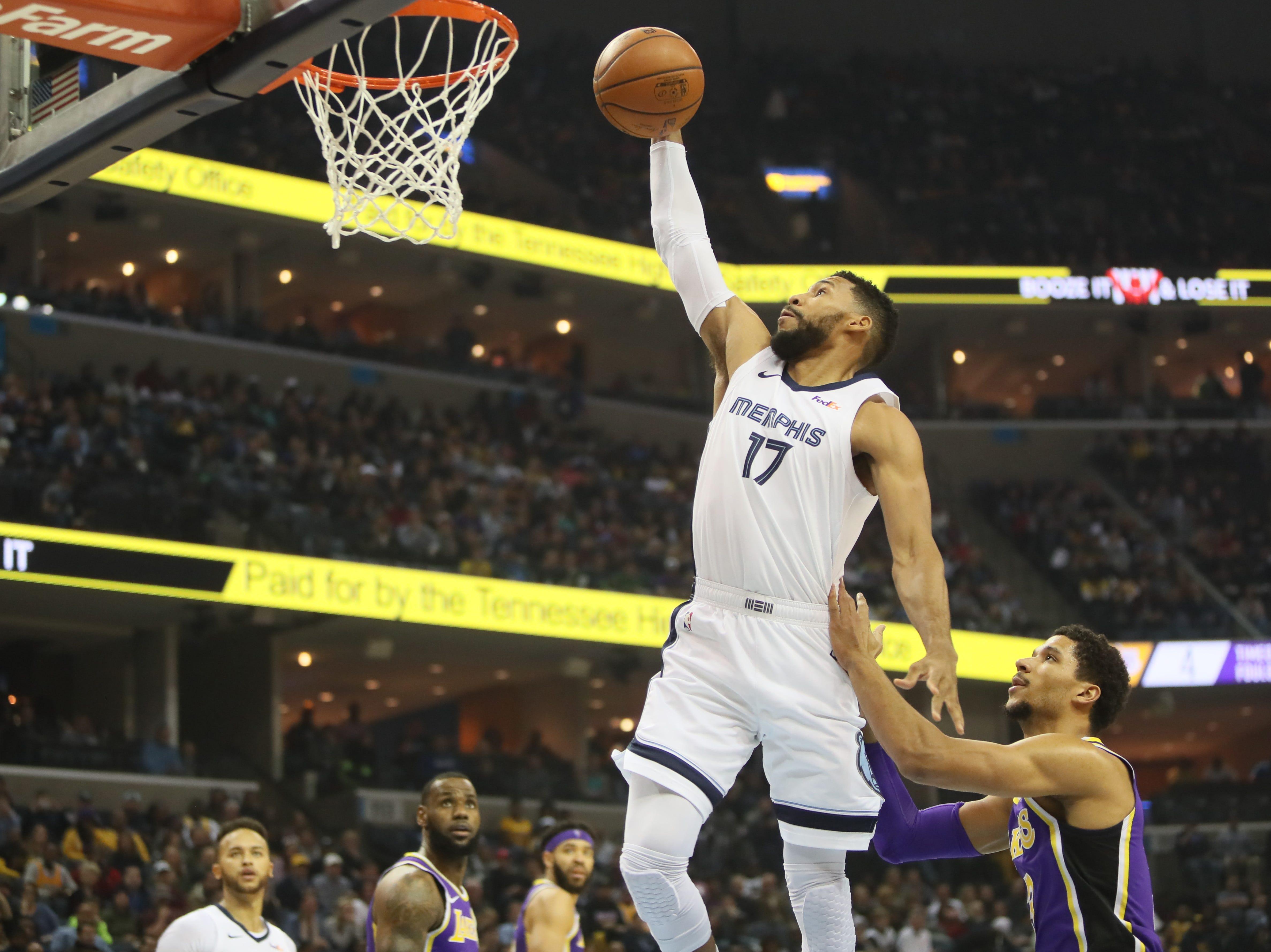 Memphis Grizzlies guard Garrett Temple dunks the ball past Los Angeles Lakers defender Josh Hart at the FedExForum on Saturday, Dec. 6, 2018.