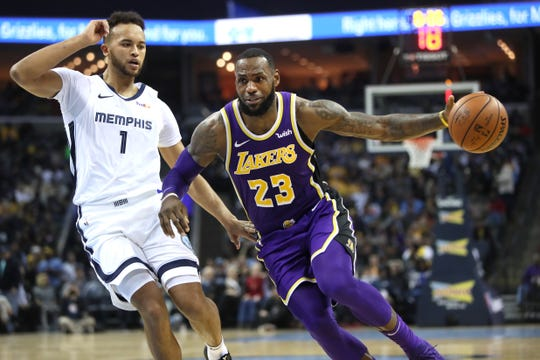 Los Angeles Lakers forward LeBron James drives past Memphis Grizzlies guard Ryan Anderson duirng their game at the FedExForum on Saturday, Dec. 8, 2018.