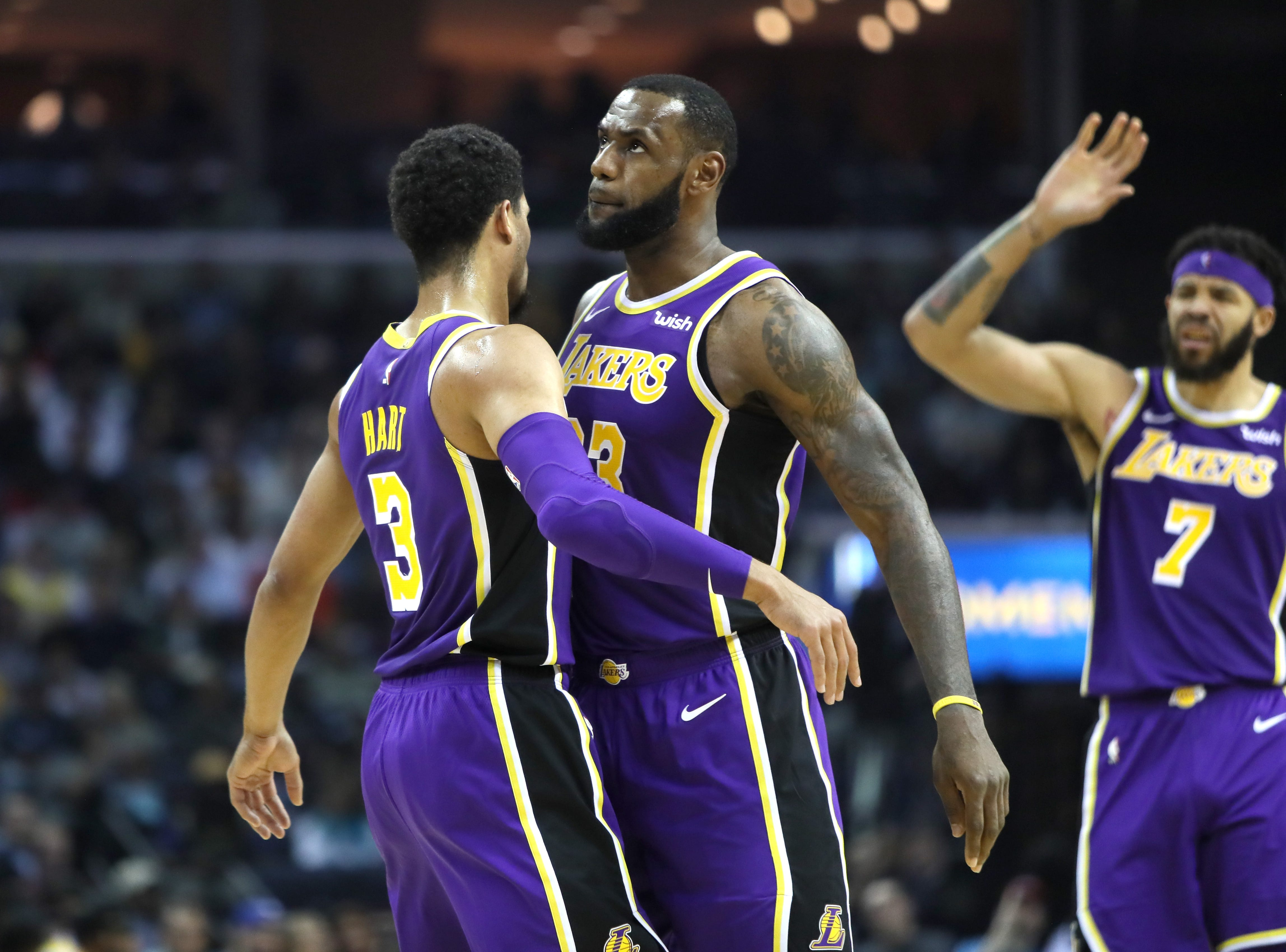 Los Angeles Lakers forward Lebron James, right, congratulates Josh Hart, left, on a made 3-pointer against the Memphis Grizzlies at the FedExForum on Saturday, Dec. 6, 2018.