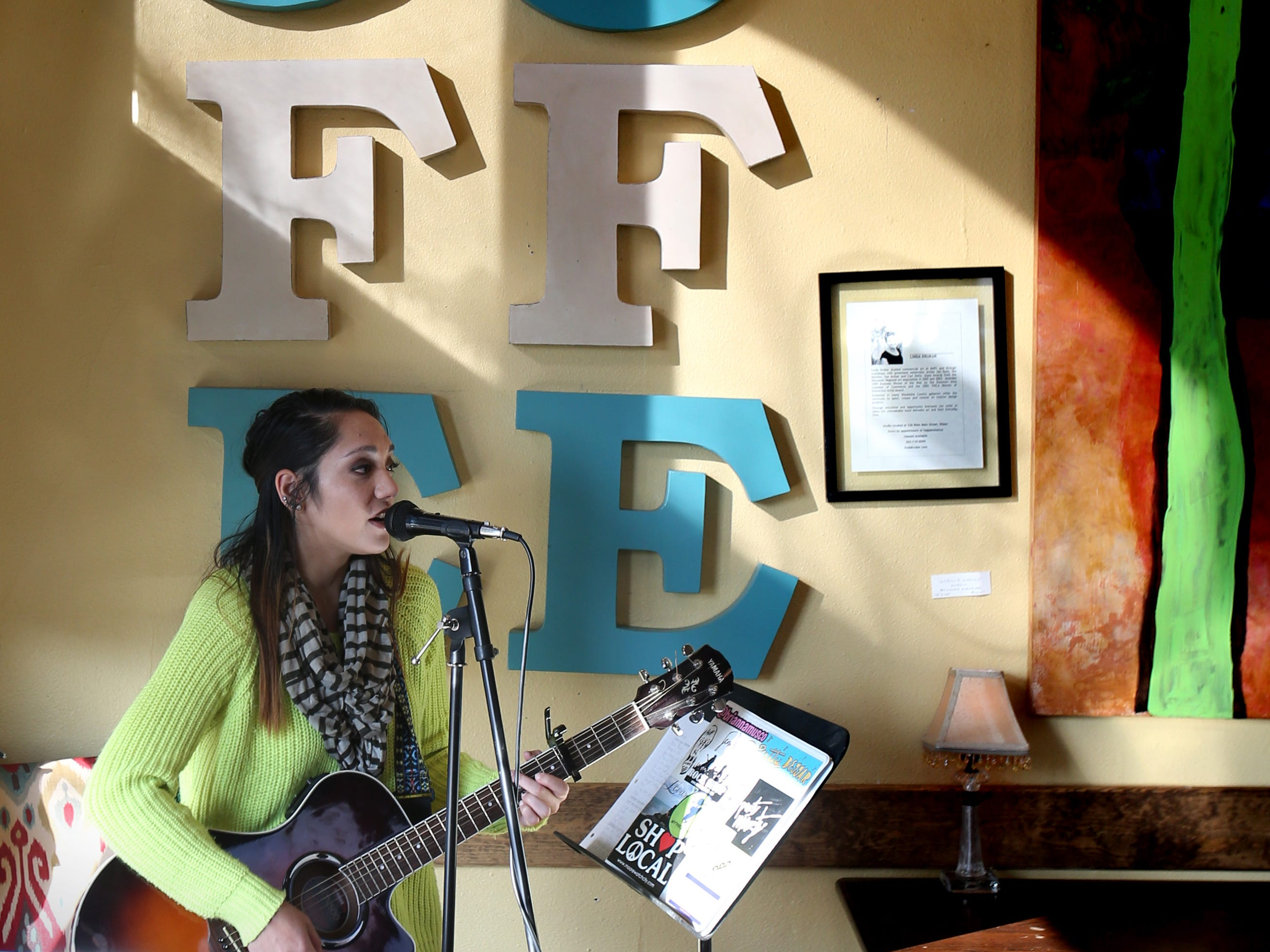 Jen Clark performs at Mama D's Coffee during Christmas in Wales on Dec. 8.