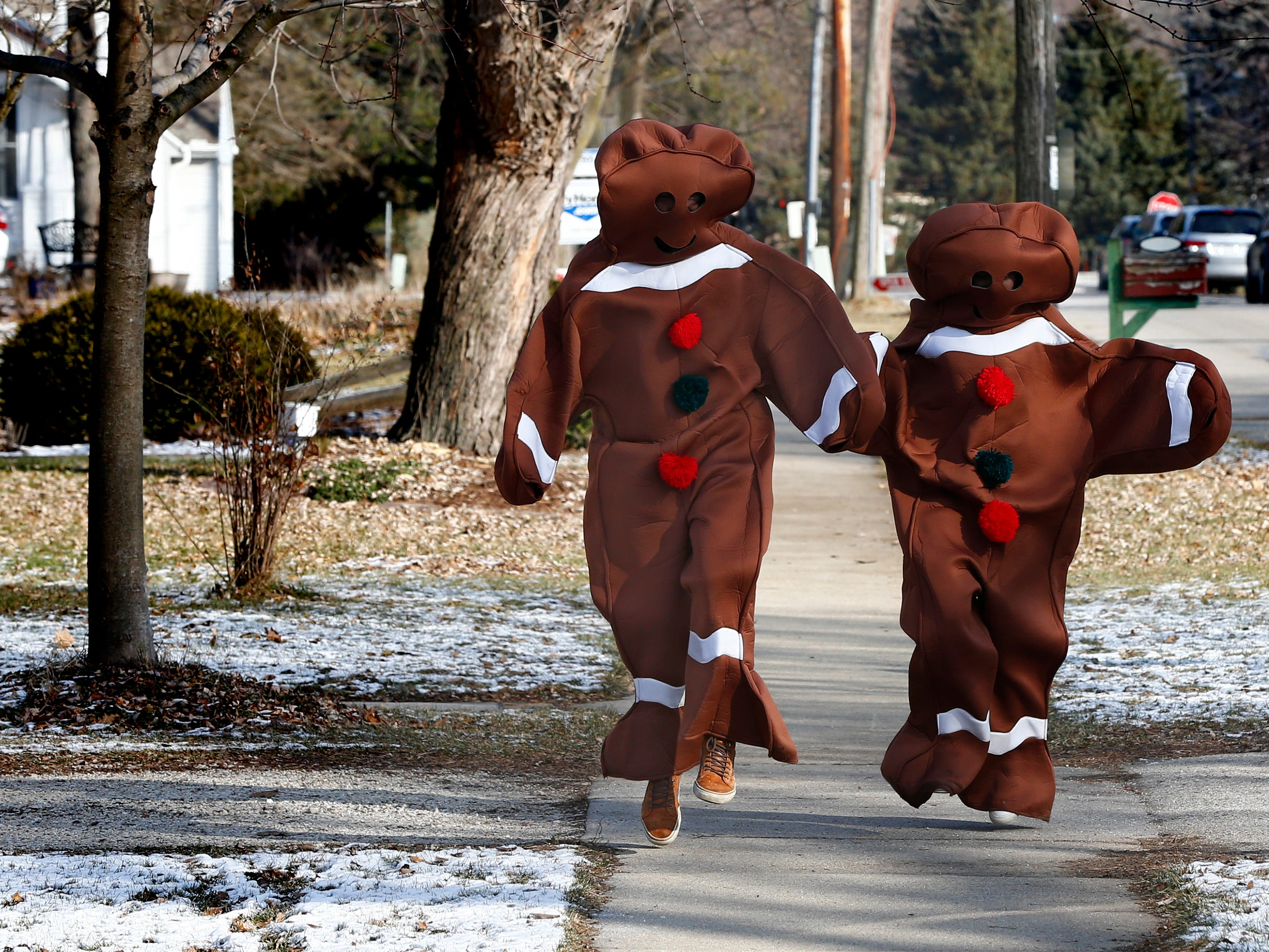 Gingerbread characters skip along Elias Street to join the activities at  Christmas in Wales on Dec. 8.