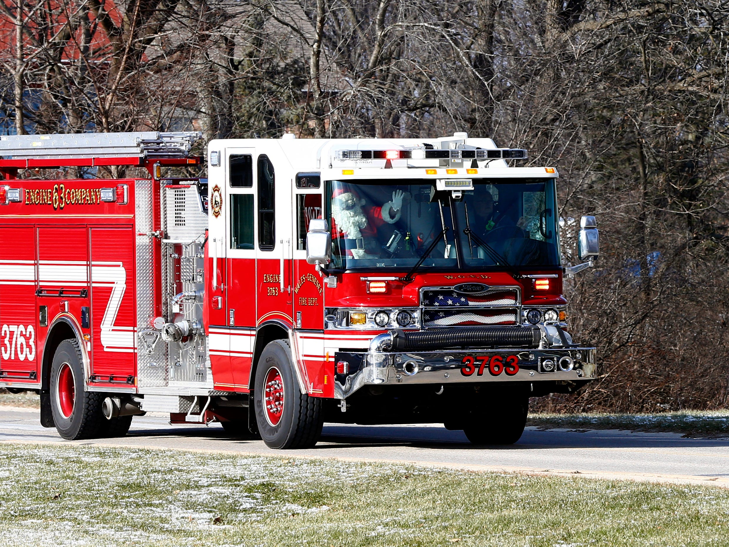 Santa rolls to the Village Hall aboard a Wales Fire Department engine for Christmas in Wales on Dec. 8.