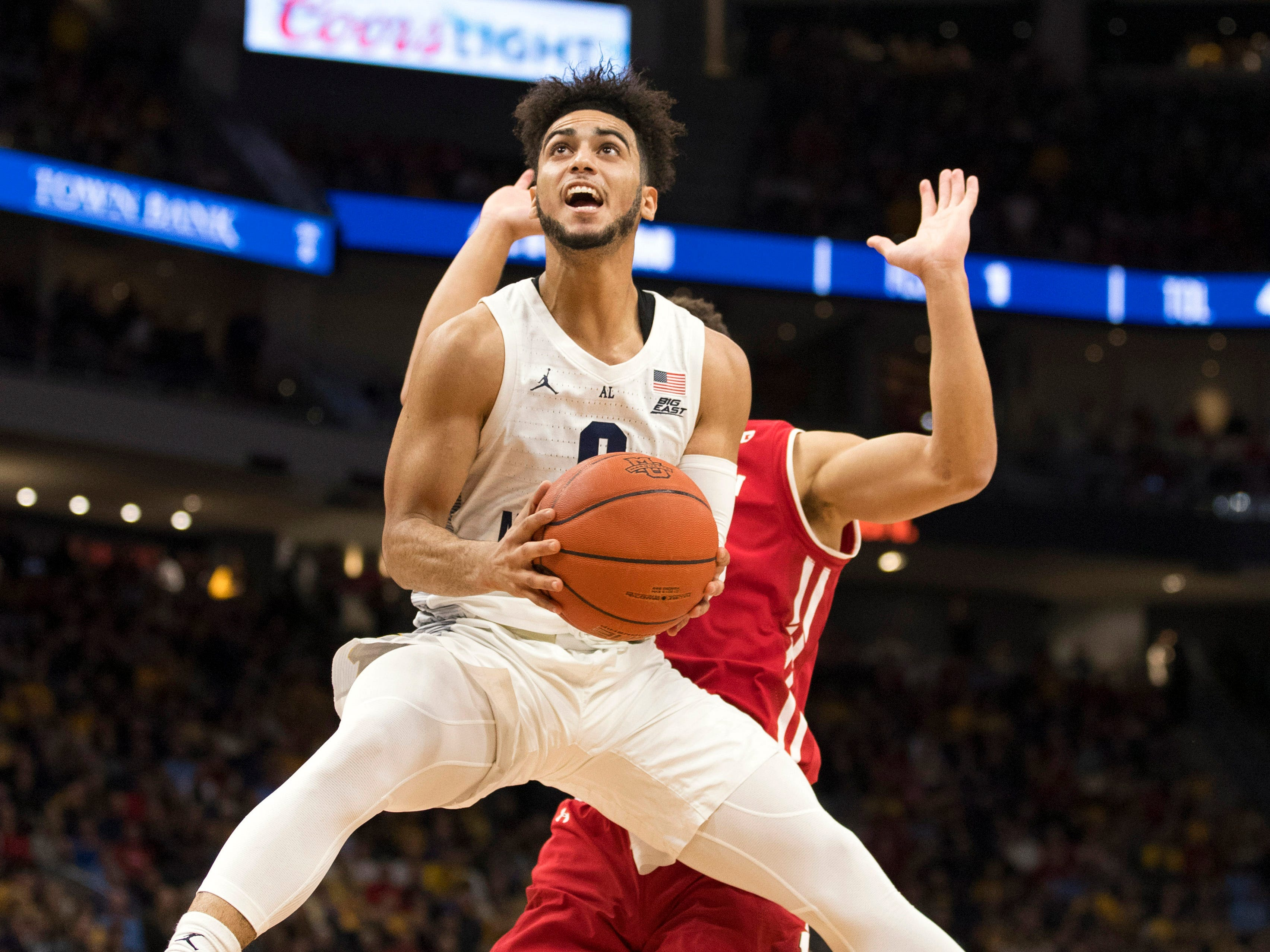 Marquette guard Markus Howard shoots during the first half.