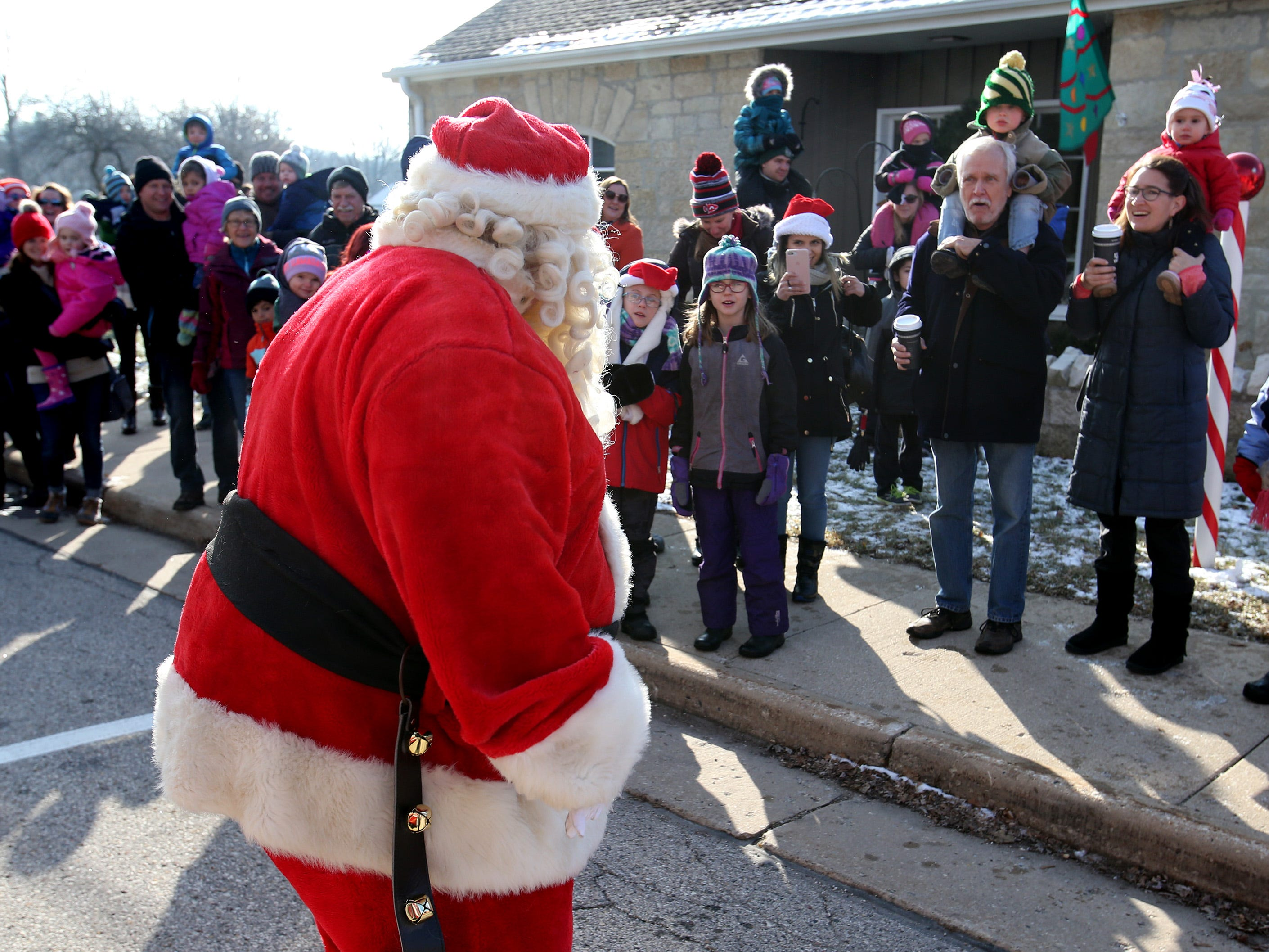 Santa arrives at the Village Hall after a ride aboard a Wales Fire Department engine for Christmas in Wales on Dec. 8.
