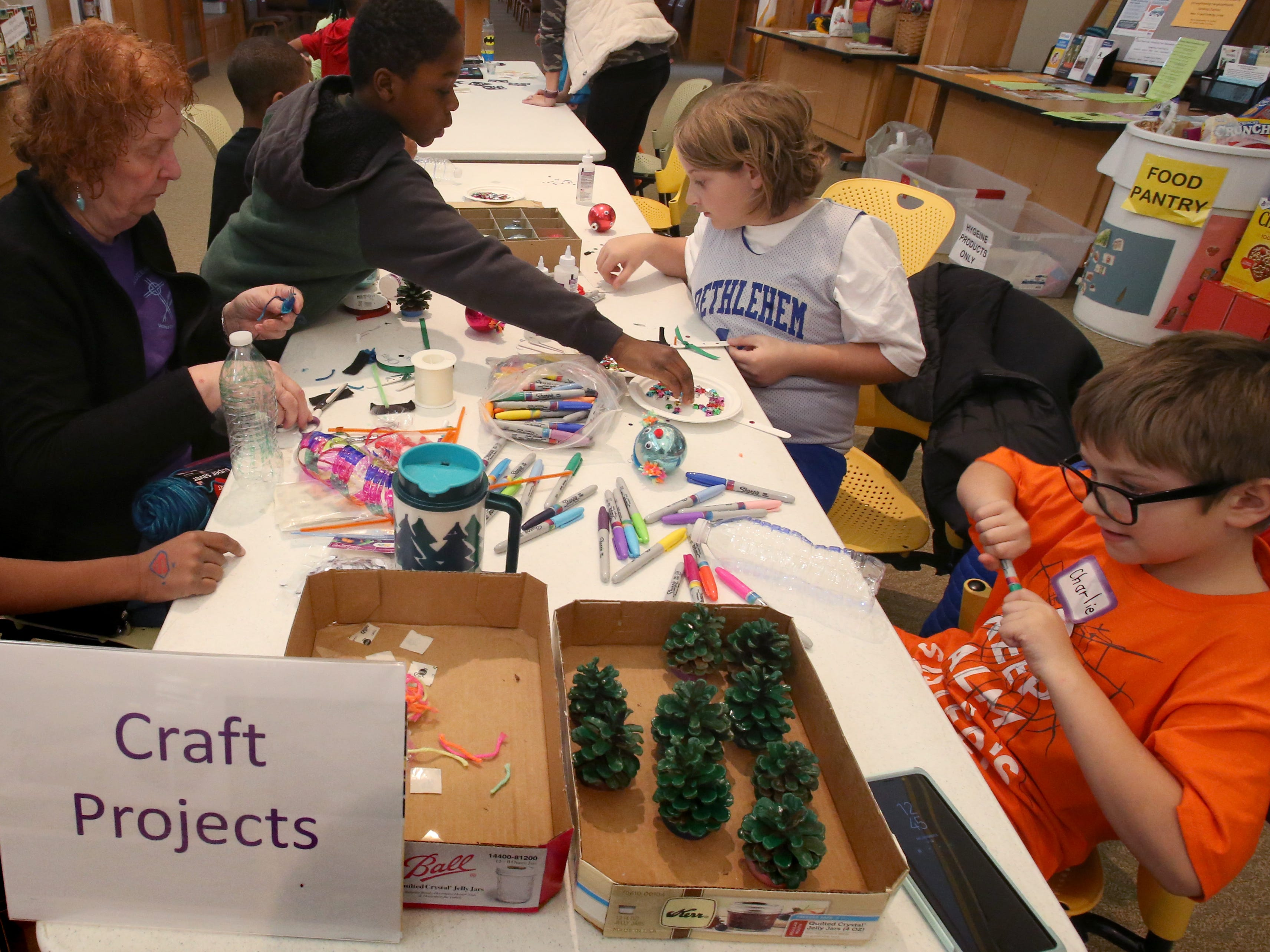 Children has an opportunity to make craft projects during the Redeemer United Church of Christ's annual Christmas Cookie Sale in Menomonee Falls on Dec. 8.