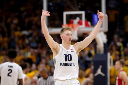 Marquette forward Sam Hauser fires up the crowd during overtime.