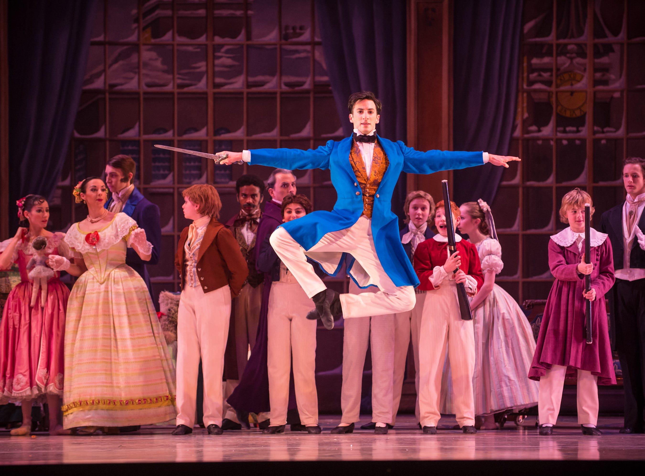 """Garrett Glassman gets airborne in Milwaukee Ballet's """"Nutcracker,"""" which continues through Dec. 26 at the Marcus Center."""