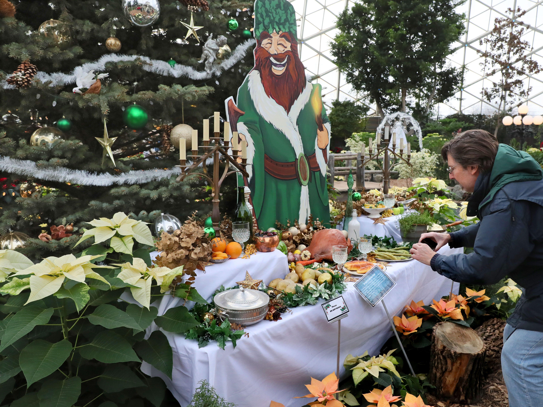 "Jim Rakowski of Oak Creek takes a photo of the ""Ghost of Christmas Present"" display."