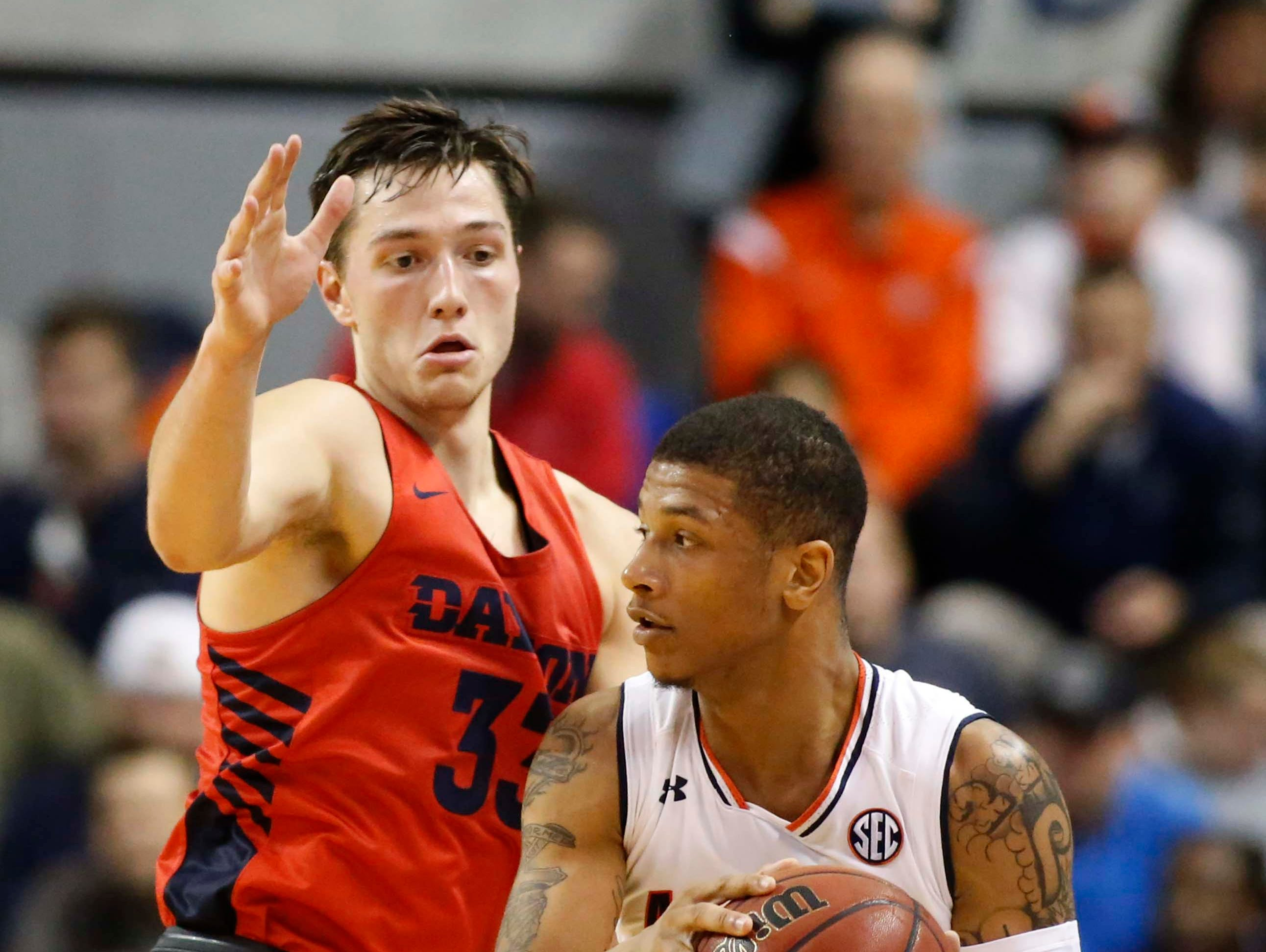 Dec 8, 2018; Auburn, AL, USA;  Auburn Tigers guard Samir Doughty (10) is pressured by Dayton Flyers forward Ryan Mikesell (33) during the first half at Auburn Arena. Mandatory Credit: John Reed-USA TODAY Sports
