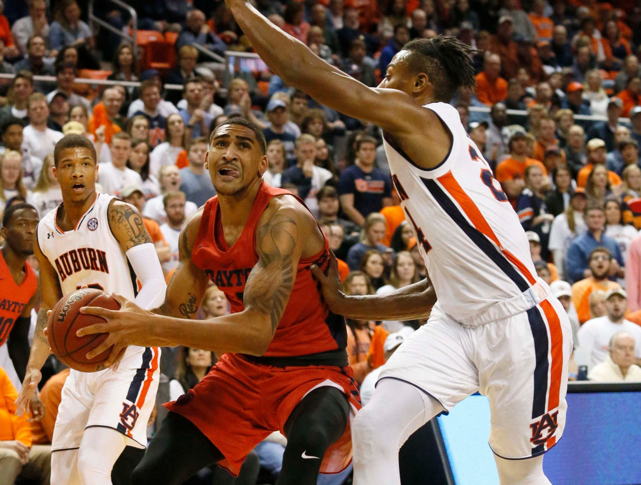 Dec 8, 2018; Auburn, AL, USA; Dayton Flyers forward Obi Toppin (1) goes for a shot as Auburn Tigers forward Anfernee McLemore (24) defends during the first half at Auburn Arena. Mandatory Credit: John Reed-USA TODAY Sports