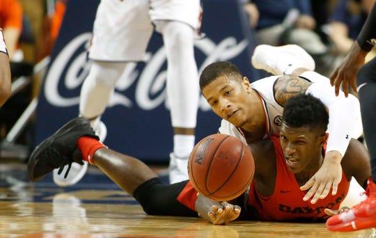 Dayton guard Dwayne Cohill (35) and Auburn guard Samir Doughty (10) battle for a loose ball at Auburn Arena on Dec. 8, 2018.