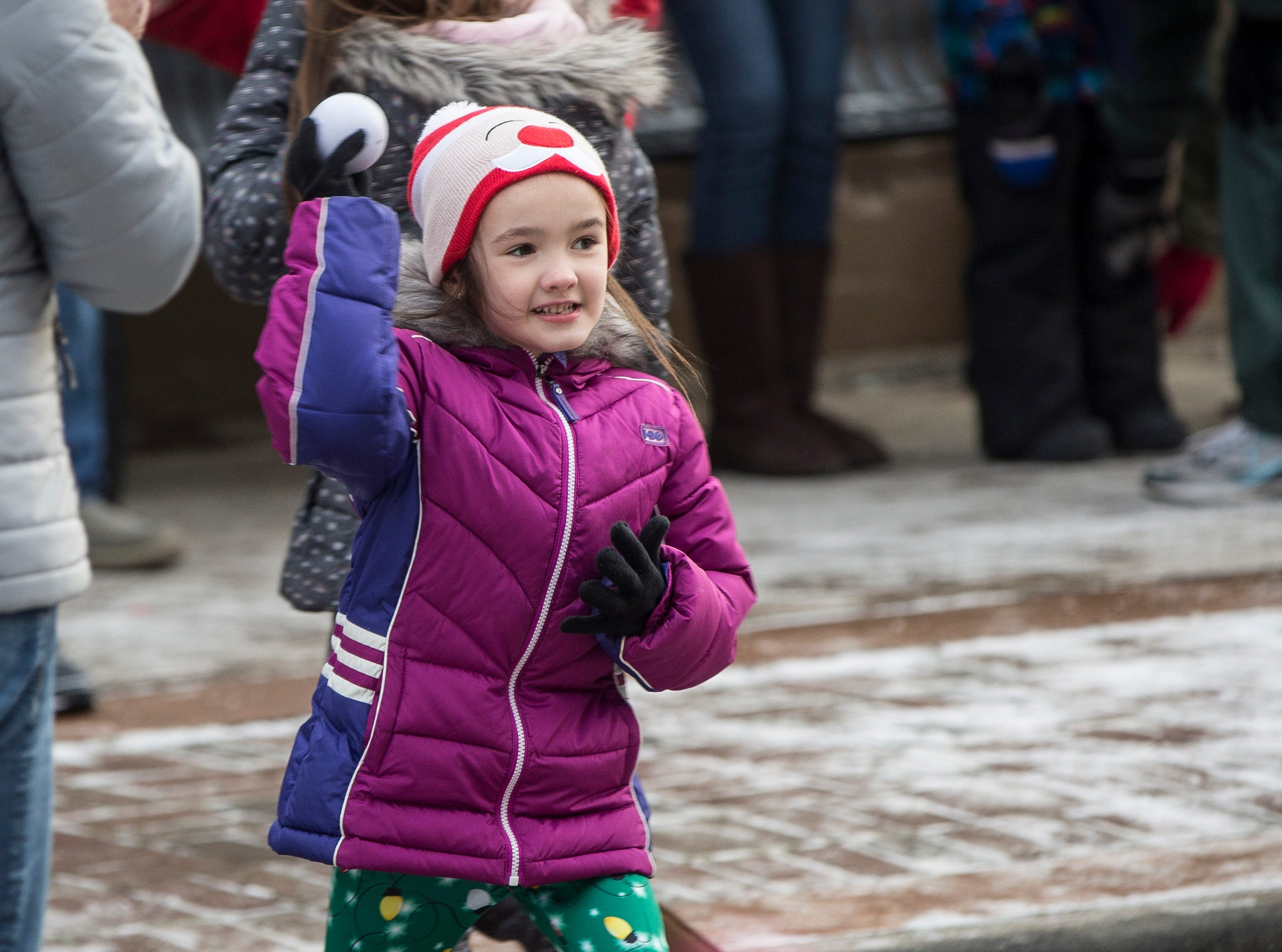 Dozens of children take part in the annual snowball fight Saturday afternoon in downtown Yorktown for the Luminary Festival.