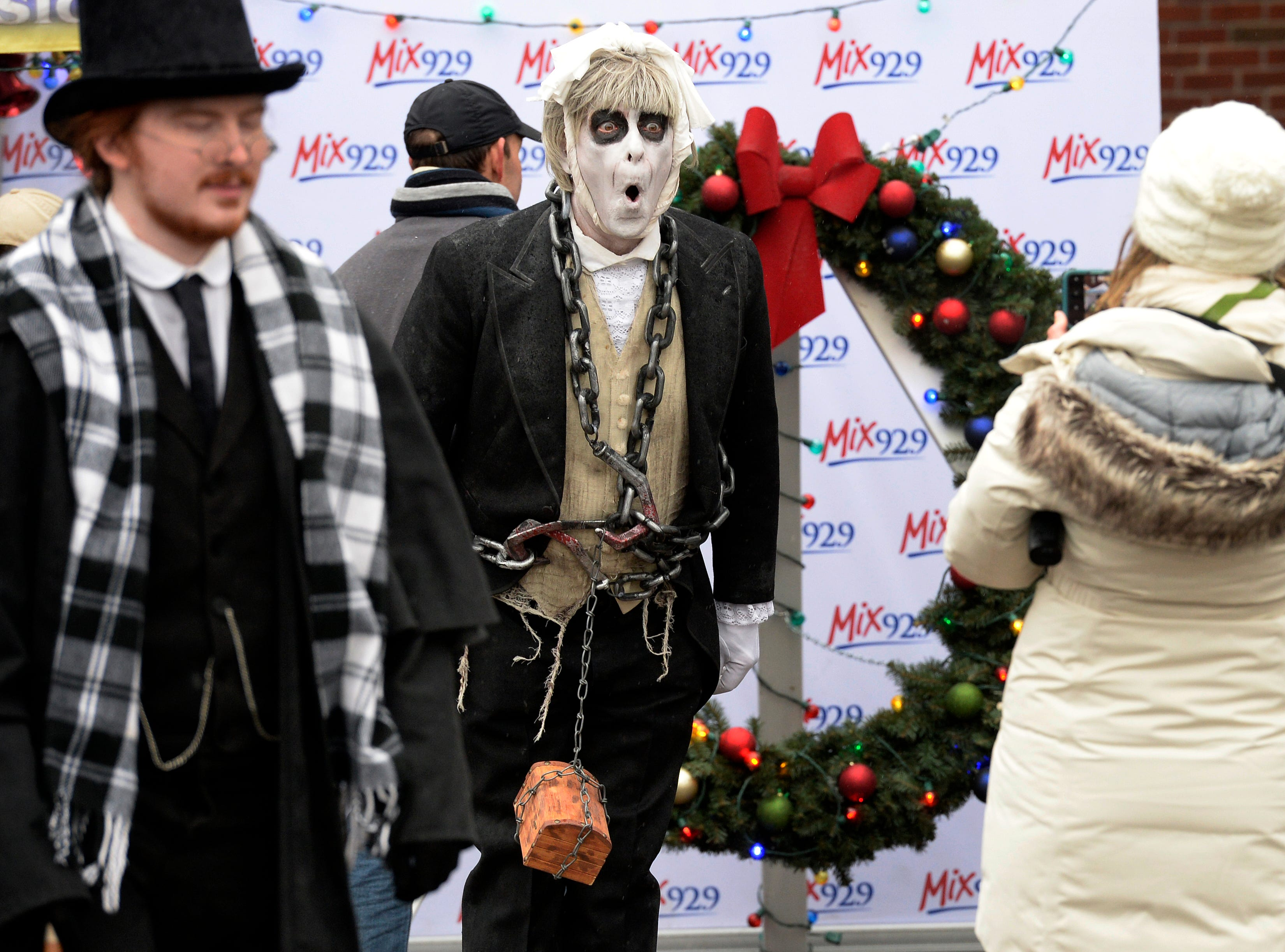 John Kitson dresses up as ghost character from A Christmas Carol as he interacts with people during the Dickens of a Christmas on Saturday, Dec. 8, 2018, in Franklin, Tenn.