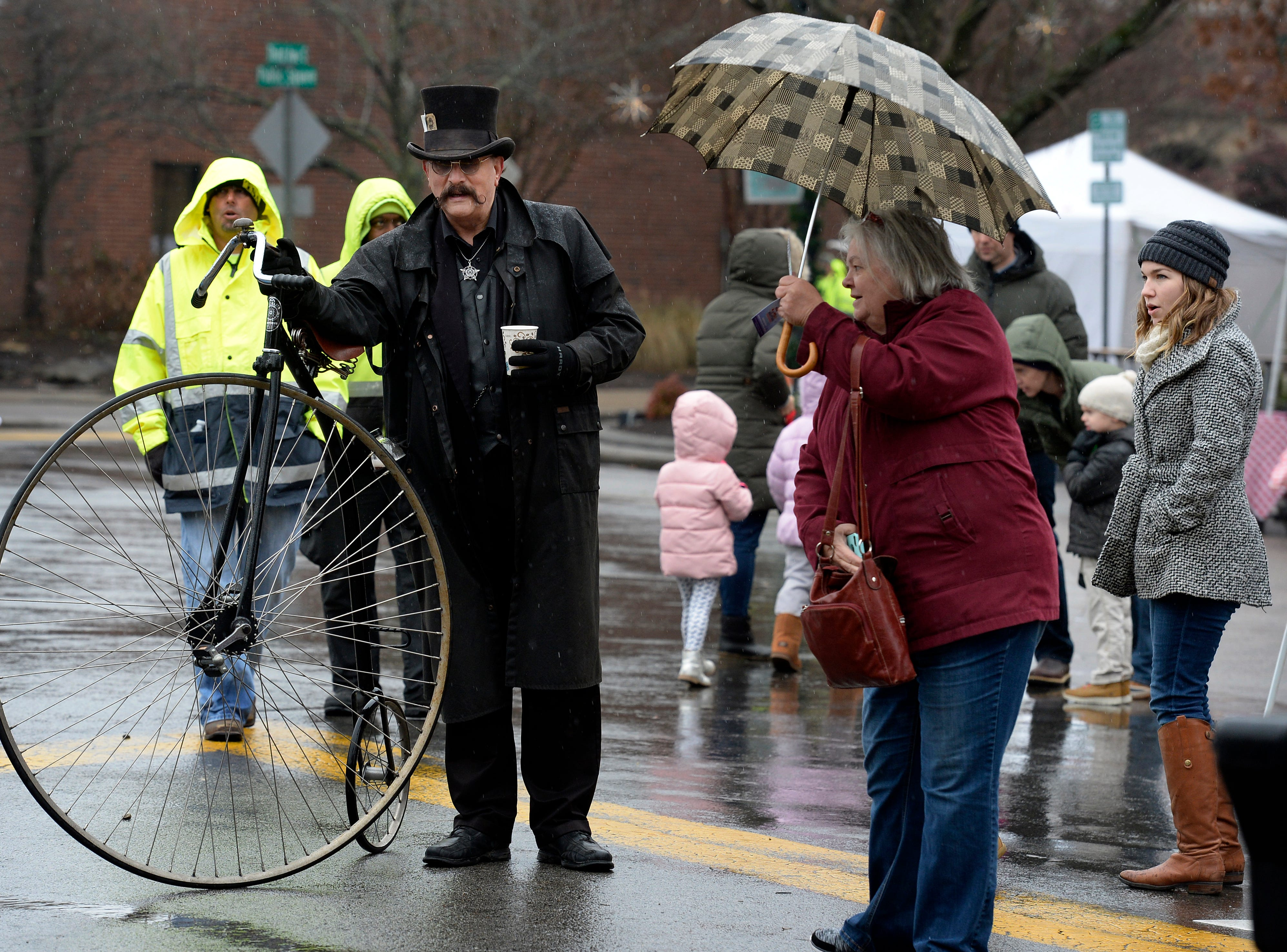 Daniel Dark, left, with his vintage bicycle during the Dickens of a Christmas on Saturday, Dec. 8, 2018, in Franklin, Tenn.