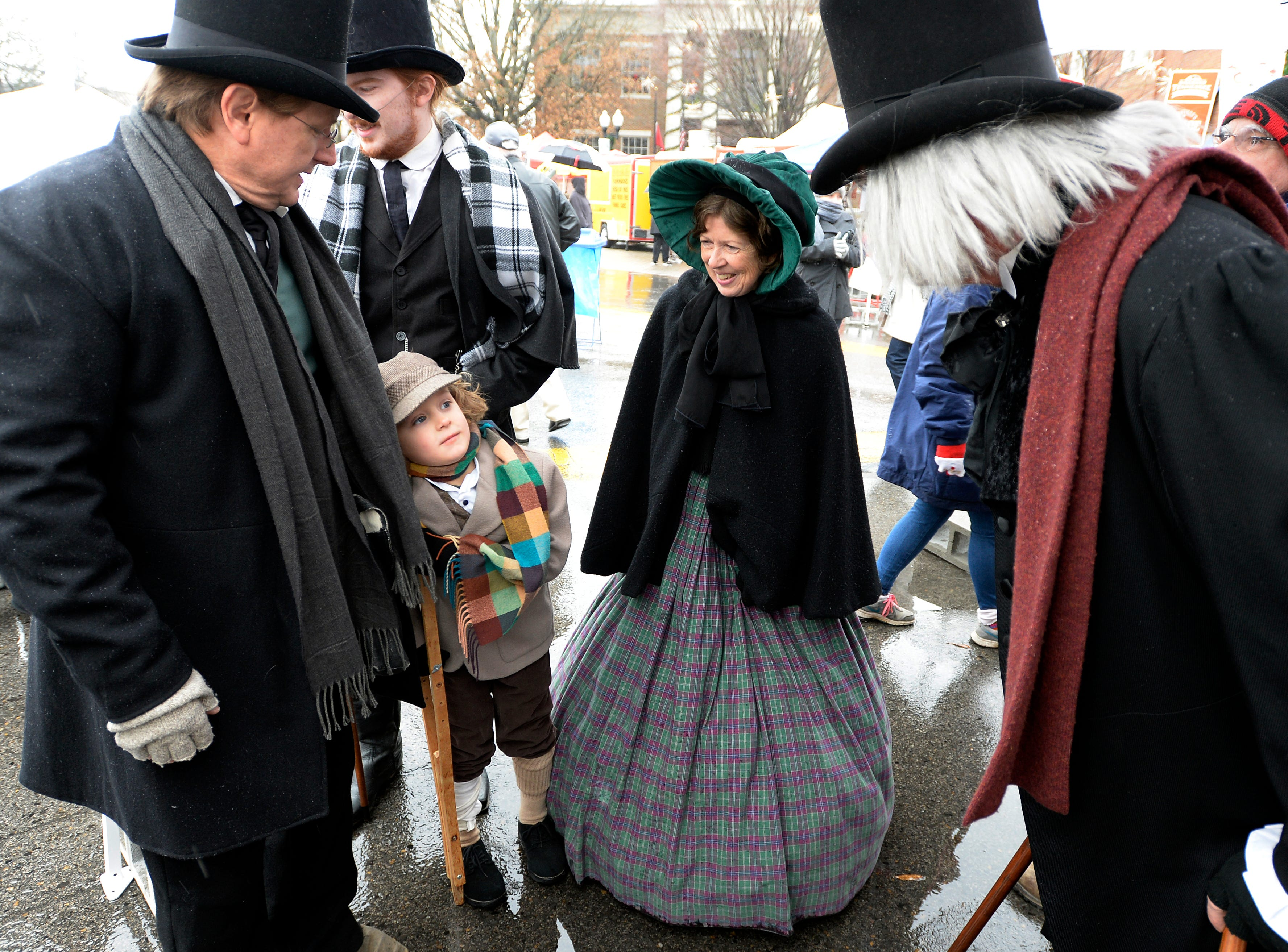 Alan Corry, left, his wife, Carla, and Andrew Nixon, 6, as Oliver Twist, spend time during the Dickens of a Christmas on Saturday, Dec. 8, 2018, in Franklin, Tenn.