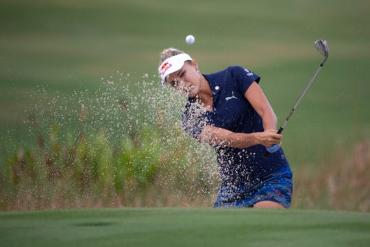 Lexi Thompson hits her ball out of the bunker on the 18th hole at the QBE Shootout at the Tiburón Golf Club, Sunday, Dec. 9, 2018 in Naples.