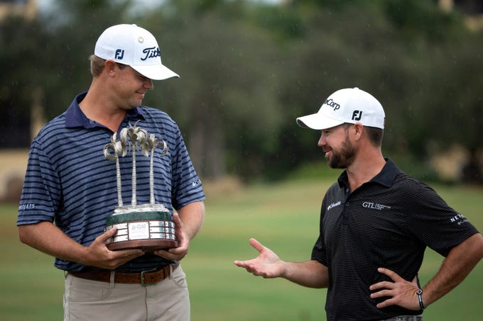 Patton Kizzire, left and Brian Harman congratulate themselves after winning the QBE Shootout at the Tiburón Golf Club, Sunday, Dec. 9, 2018 in Naples.
