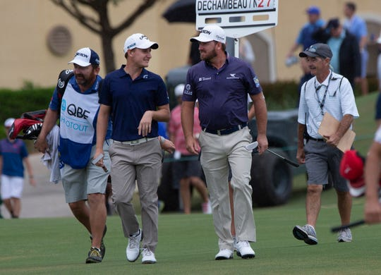 Emiliano Grillo, second to the left, and Graeme McDowel make their way to the 18th green during the QBE Shootout at the Tiburón Golf Club on Sunday.