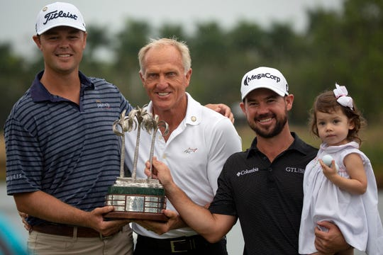 Patton Kizzire, left, Greg Norman, Brian Harman and Harman's daughter Marie Harman pose for photos after receiving the QBE Shootout tournament trophy at the Tiburón Golf Club on Sunday, Dec. 9, 2018, in North Naples.