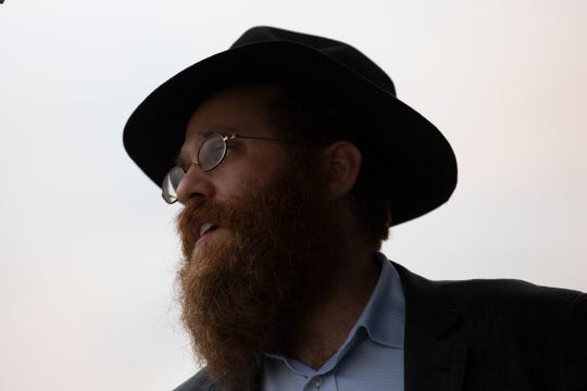 Rabbi Mendy Greenberg, of the Chabad of Bonita Springs, sings a few traditional tunes during the Hanukkah celebration put up by the Chabad of Bonita Springs & Estero, Sunday evening, Dec. 9, 2018.