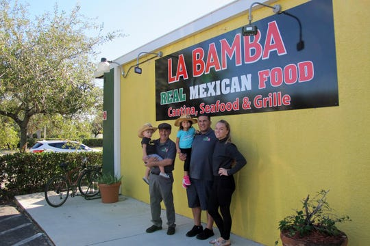 Giuseppe Rinaldi, left, with grandchildren Rio and Jobi and son Mariano Rinaldi and his wife, Monica, outside the new La Bamba Mexican restaurant on Airport-Pulling Road in East Naples.