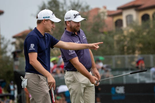 Emiliano Grillo, left, and Graeme McDowell study the 18th green during the QBE Shootout at the Tiburón Golf Club on Sunday.