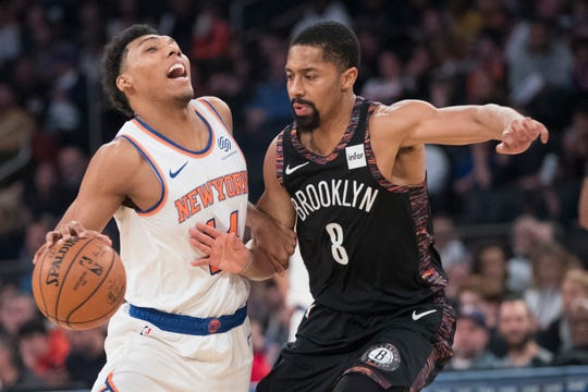 New York Knicks guard Allonzo Trier (14) drives against Brooklyn Nets guard Spencer Dinwiddie (8) during the first half of an NBA basketball game, Saturday, Dec. 8, 2018, at Madison Square Garden in New York.