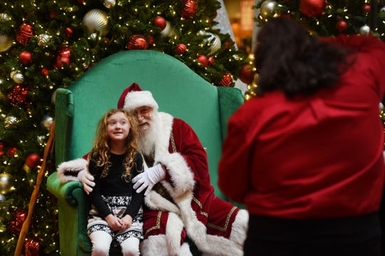 Autumn Palko (age 7) of Sparta has her picture taken with Santa during the special event called Caring Santa at Rockaway Townsquare in Rockaway on 12/09/18.