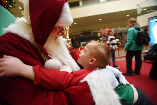 Jackson Roberts (age 6) of Augusta, takes a close up look into Santa's face as they hug each other during the special event called Caring Santa at Rockaway Townsquare in Rockaway on 12/09/18.