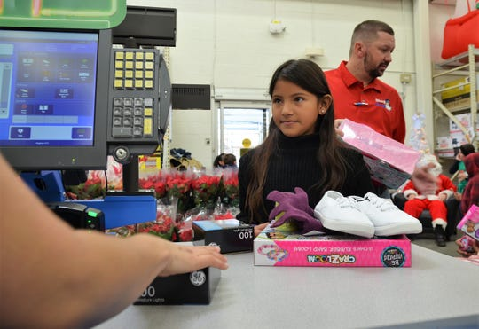 Martha Gonzales, 10, of Columbus Elementary School purchased a pair of shoes, socks, gloves, pajamas, slippers, a bracelet-making kit and two boxes of Christmas lights for her Christmas tree at home she said.