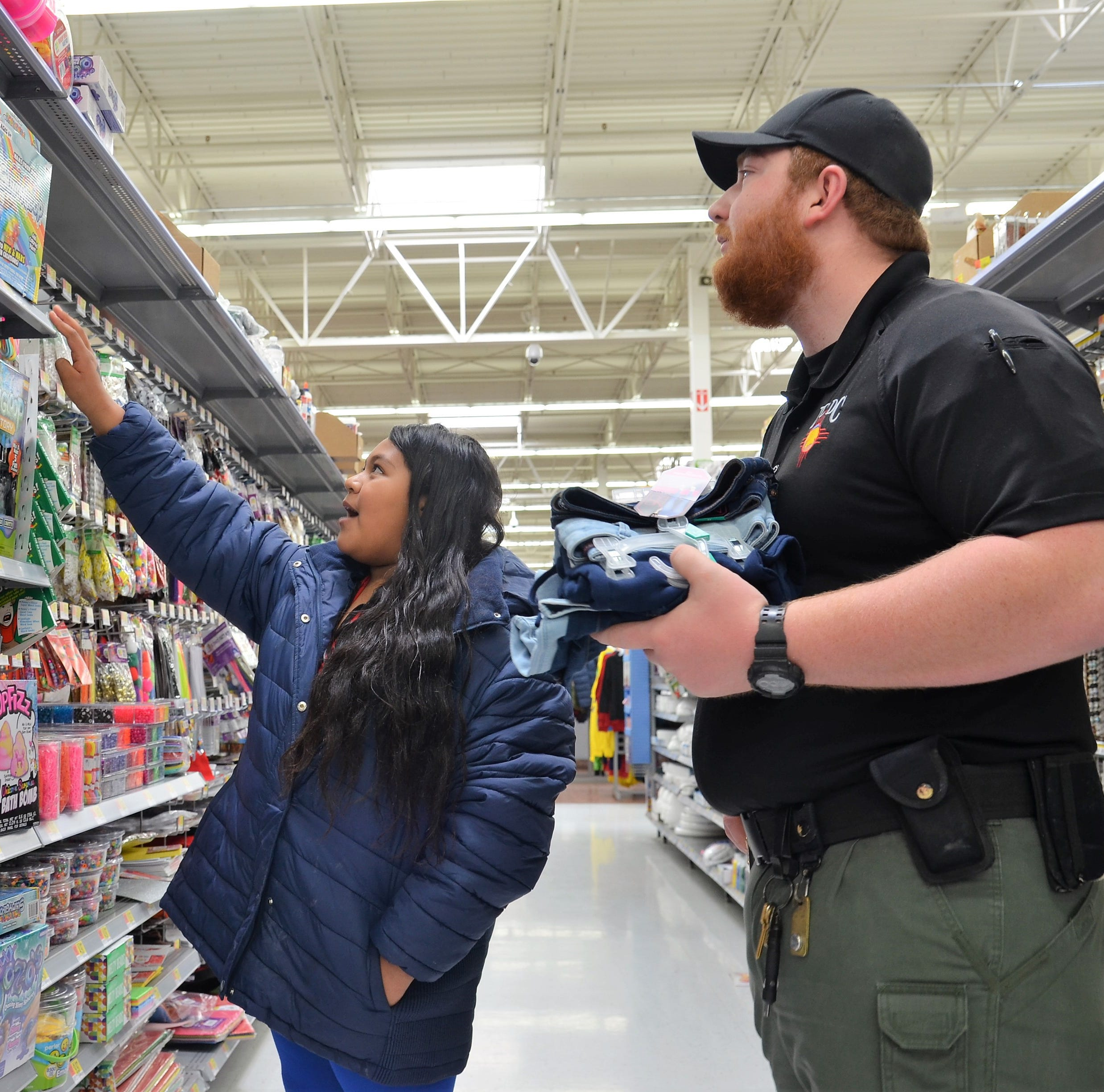 Local law enforcement get in holiday spirit with Shop with a Cop program in Deming, NM