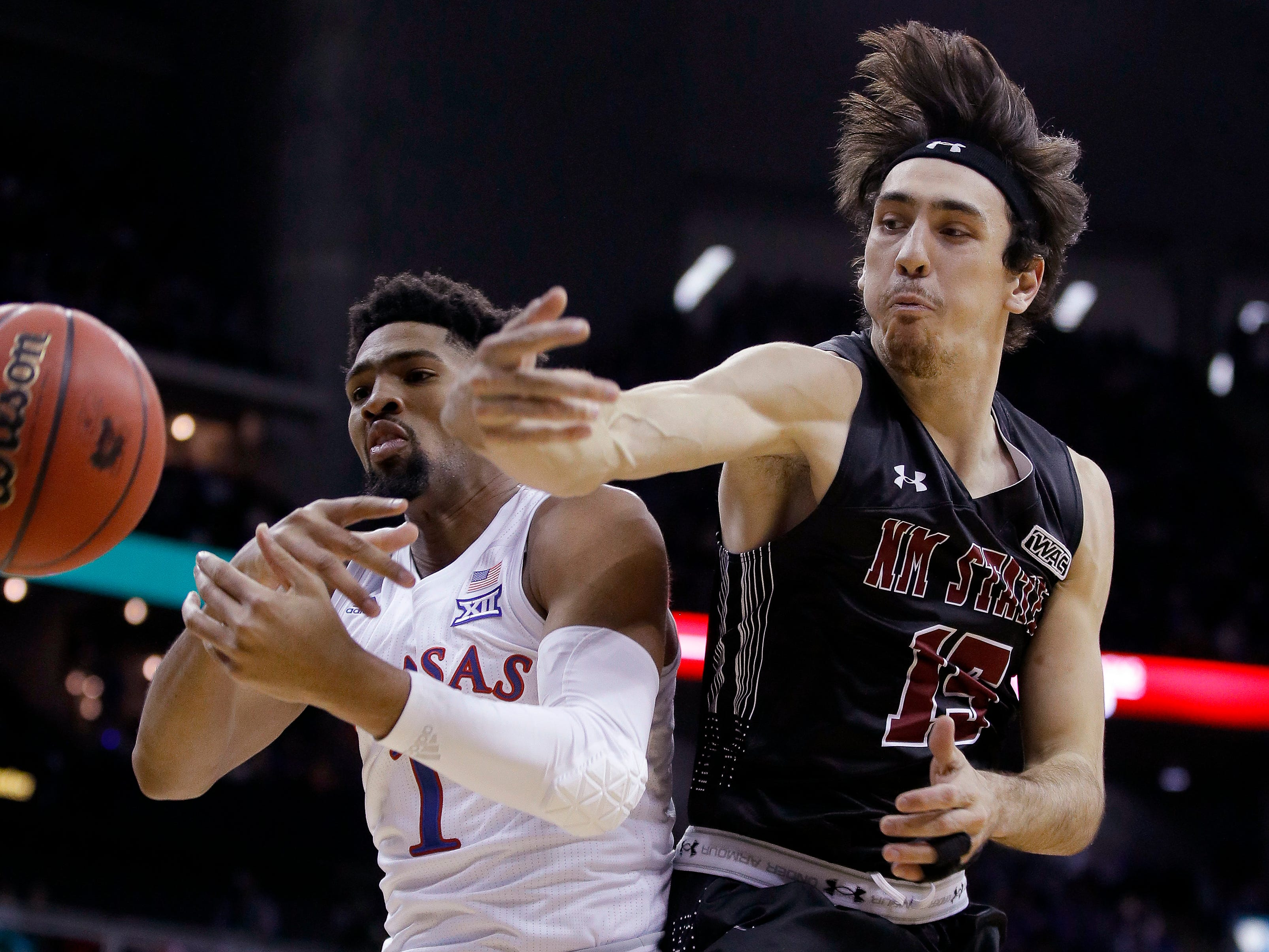 No. 2 Kansas comes back late to top New Mexico State