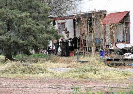 Otero County Sheriff's Office deputies get ready to enter a home in the 600 block of Old Mescalero Road while searching for Daniel McKinley Friday, Dec. 7, 2018.