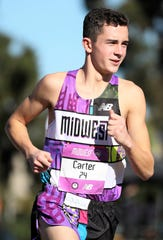 Plymouth High's Carter Solomon comes out for the pre-race introductions at the Foot Locker Cross Country National Championships on Dec. 8 at Balboa Park in San Diego, Calif.