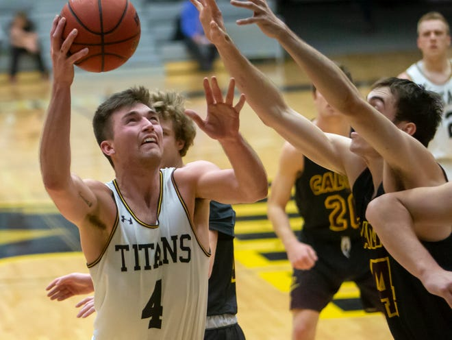 UW-Oshkosh's Brett Wittchow goes up for a basket at Kolf Sports Center on Dec. 8, 2018. The former Laconia High School standout is playing professionally in Germany.