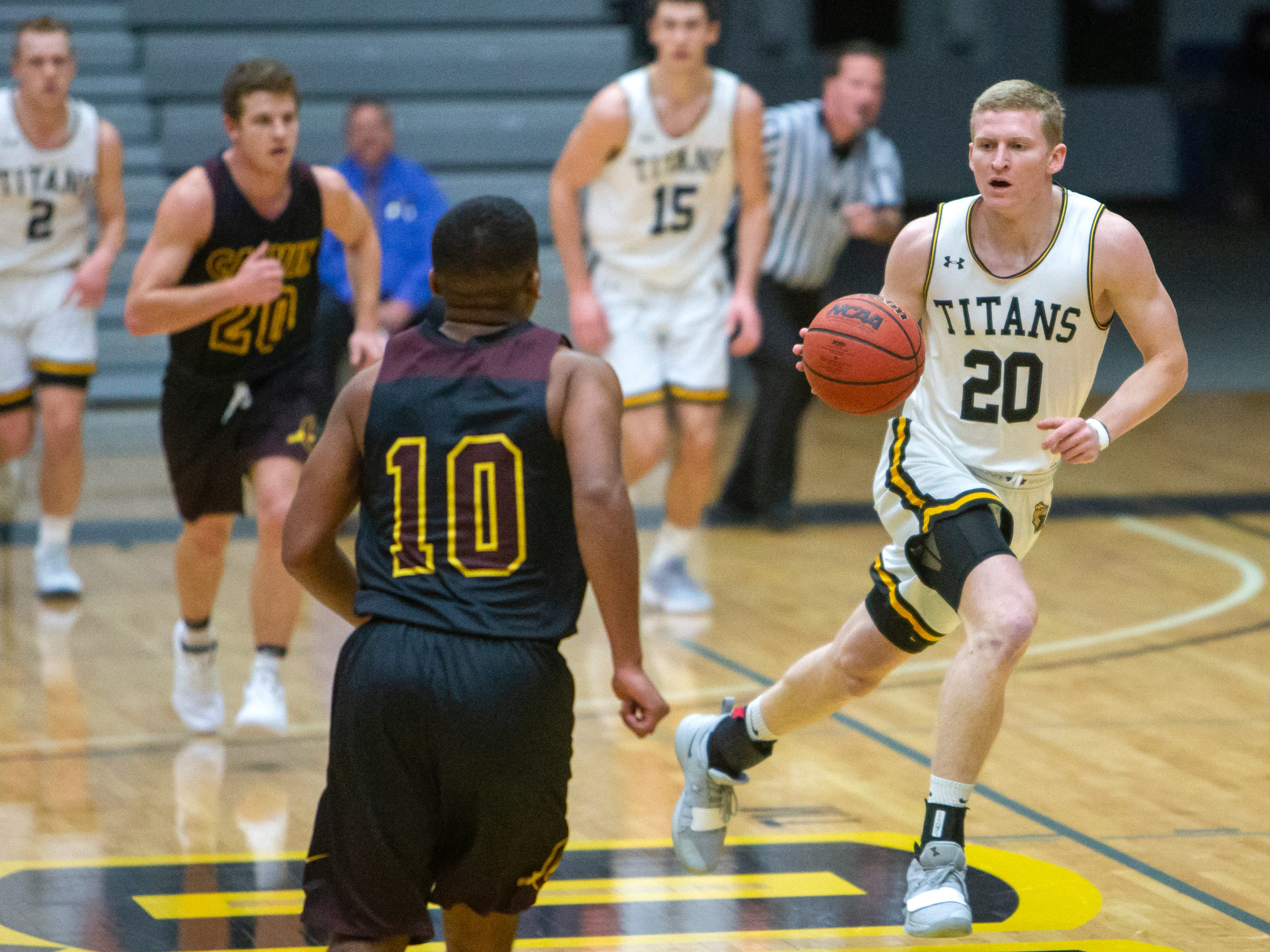 UW-Oshkosh's Connor Duax moves the ball across the court at the Kolf Sports Center on Saturday, December 8, 2018.