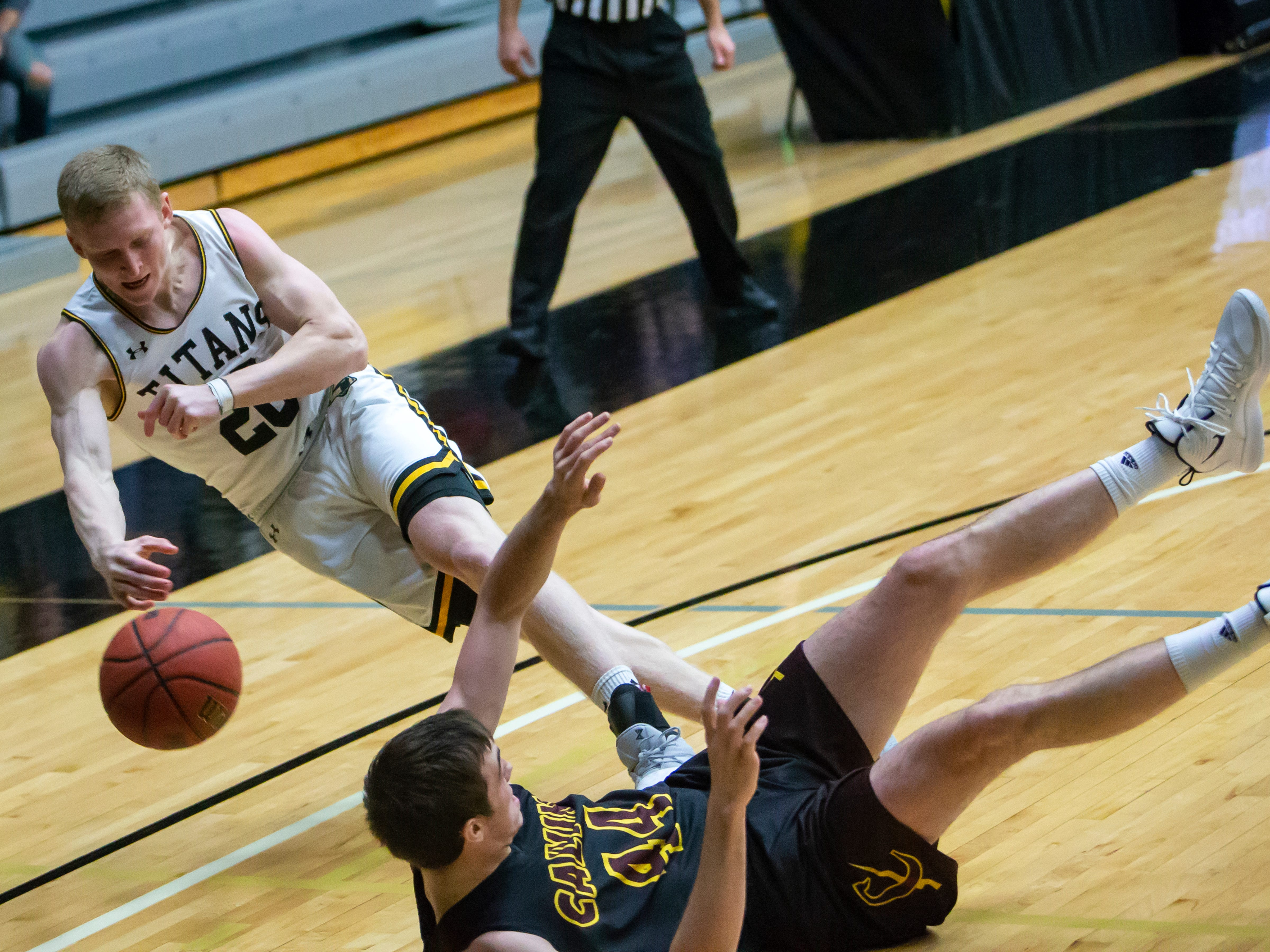 UW-Oshkosh's Connor Duax attempts to save the ball from out of bounds at the Kolf Sports Center on Saturday, December 8, 2018.
